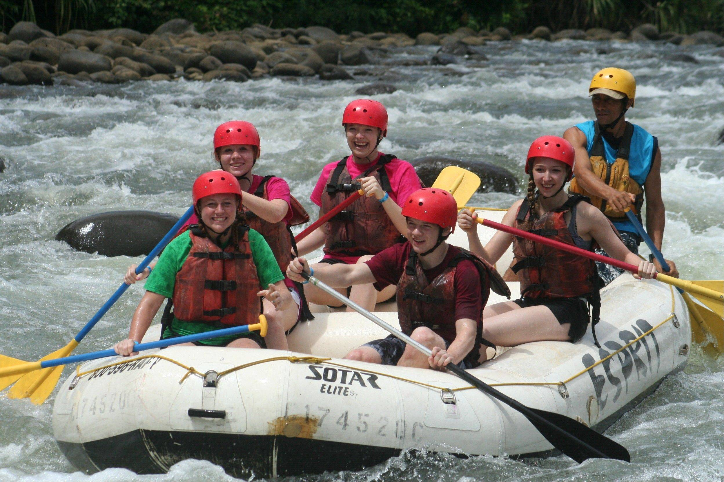 After completing their school work, Emily Longo, Claire Cason, Holly Giglio, Keagan Cornier and Tara Charvat, Schaumburg High School Spanish students, enjoy some free time white water rafting down the Sarapiqui River.