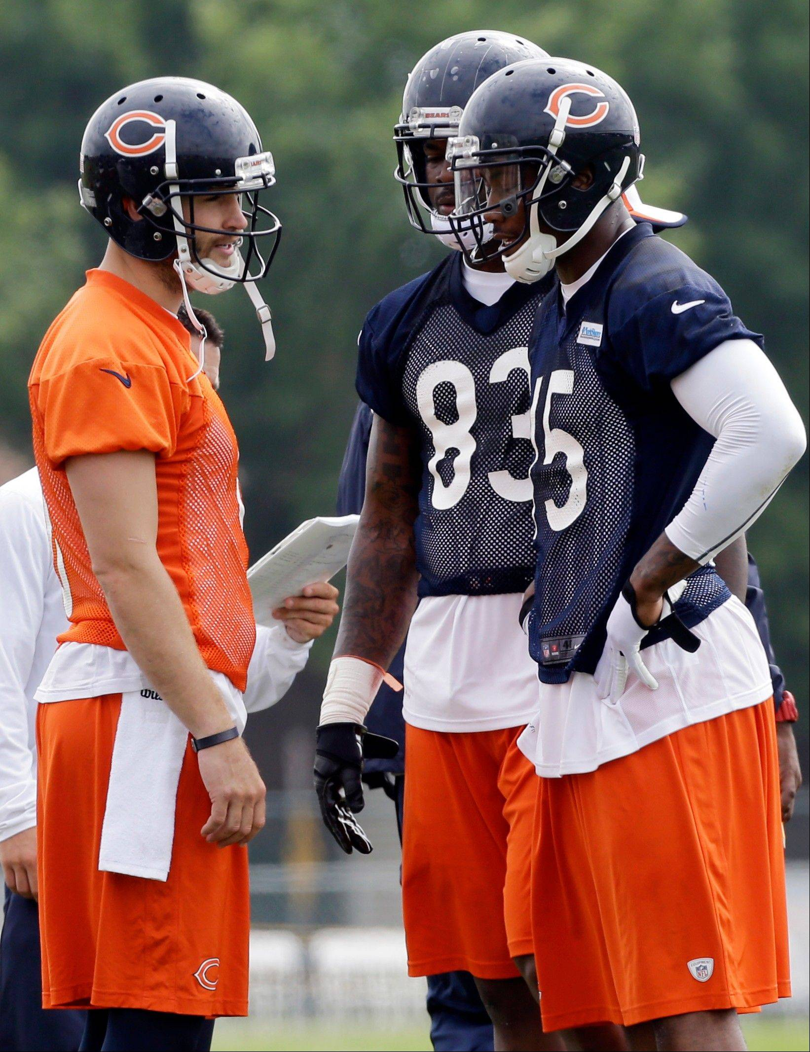 Bears quarterback Jay Cutler, left, has some big options in the red zone with 6-foot-4 wide receiver Brandon Marshall (15) and 6-6 tight end Martellus Bennett (83). He'll also have 6-3 WR Alshon Jeffery to target as well.