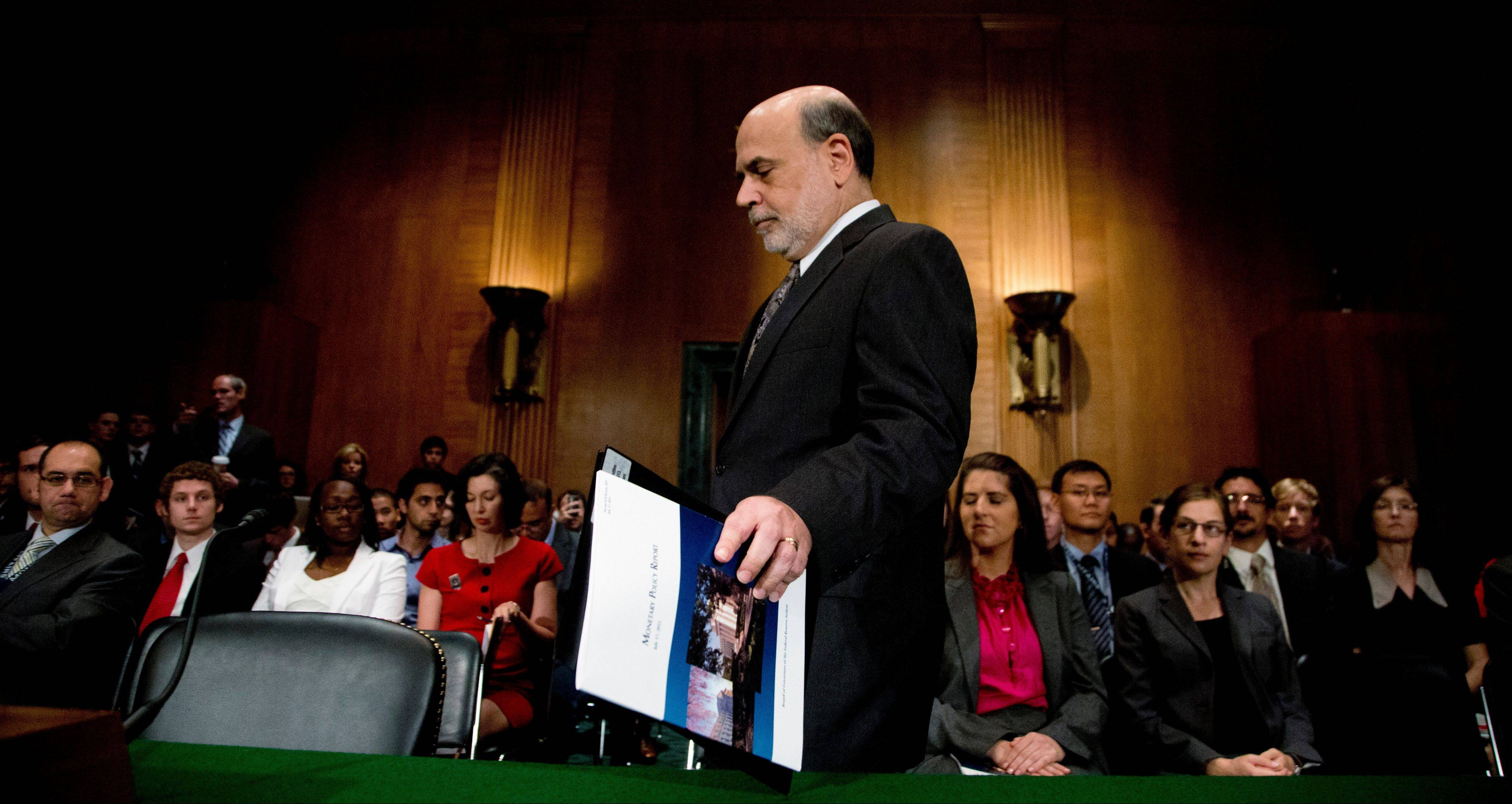 Federal Reserve Chairman Ben Bernanke arrives to testify before the Senate Banking, Housing, and Urban Affairs Committee hearing on July 18. The Federal Reserve issued a statement after its two-day policy meeting ended Wednesday, throttling back on its optimism over the nation's economic recovery.