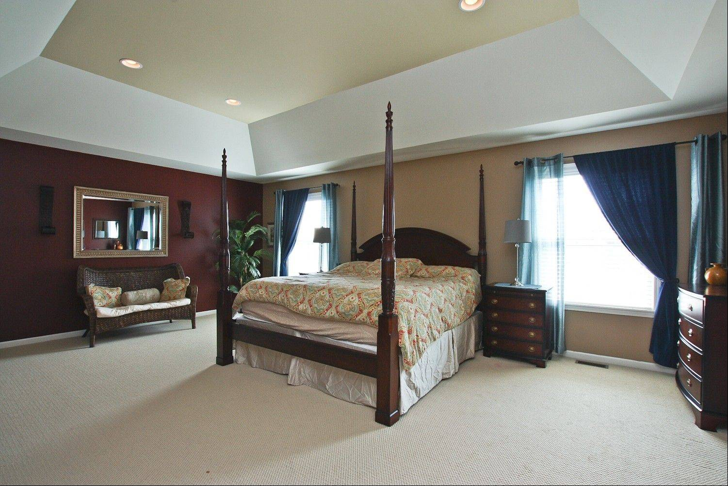 The master suite has a vaulted ceiling and two walk-in closets.