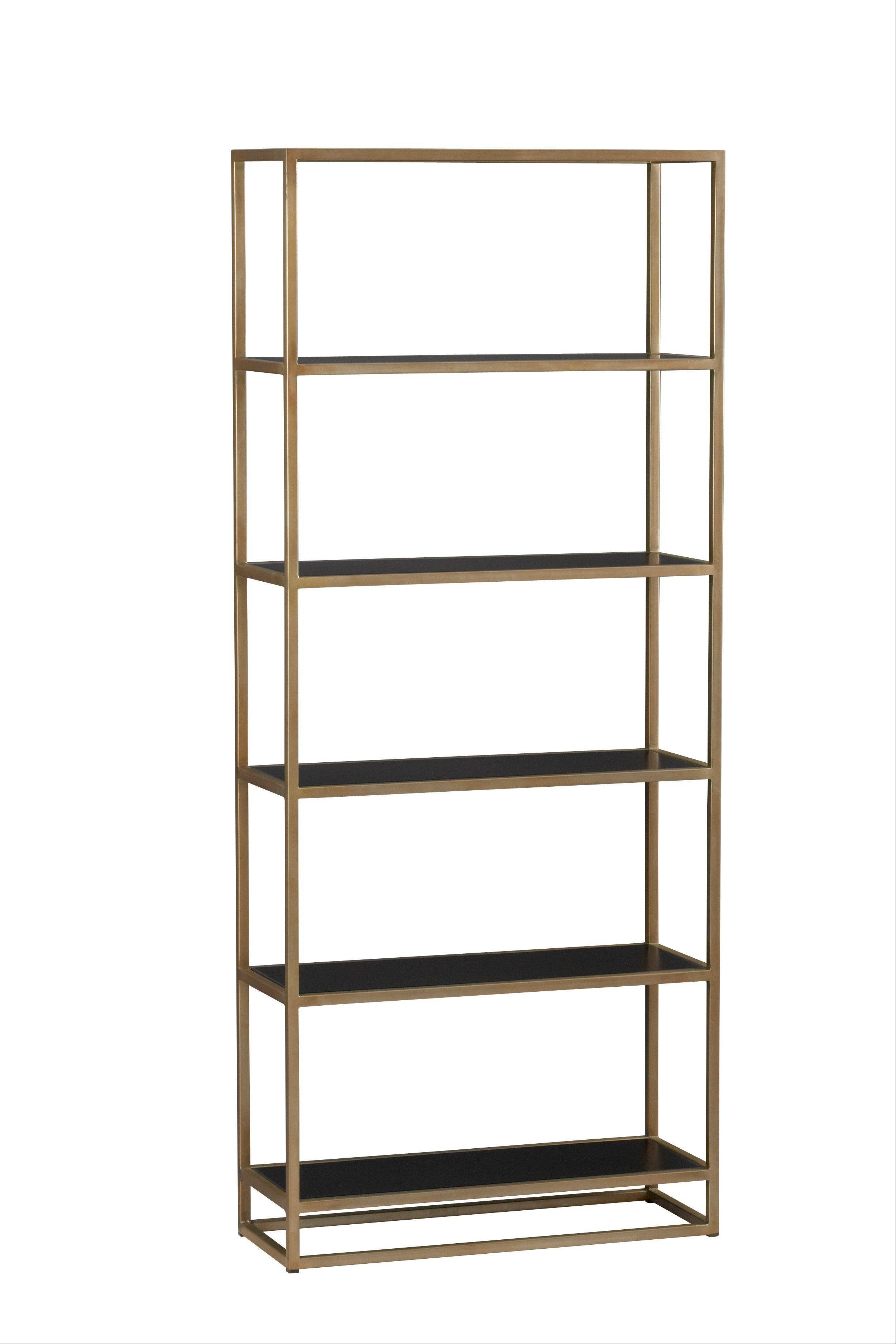 A Remi bookcase comes with a slender frame and is finished in a warm antique brass inset with handsome black powdercoat shelves.