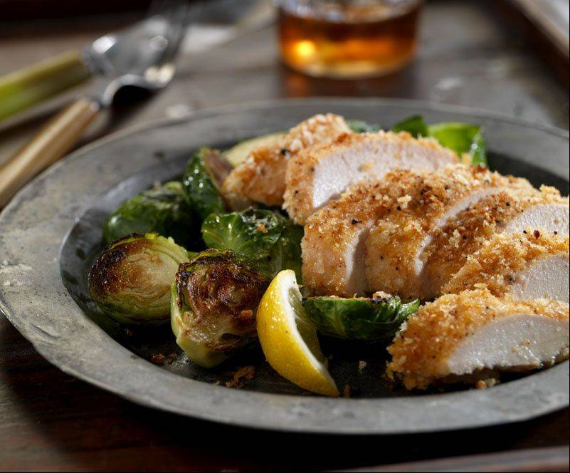 "Roasted brussels sprouts and baked buttermilk-soaked chicken from ""Art Smith's Healthy Comfort: How America's Favorite Celebrity Chef Got It Together, Lost Weight, and Reclaimed His Health!"" form a healthy meal."