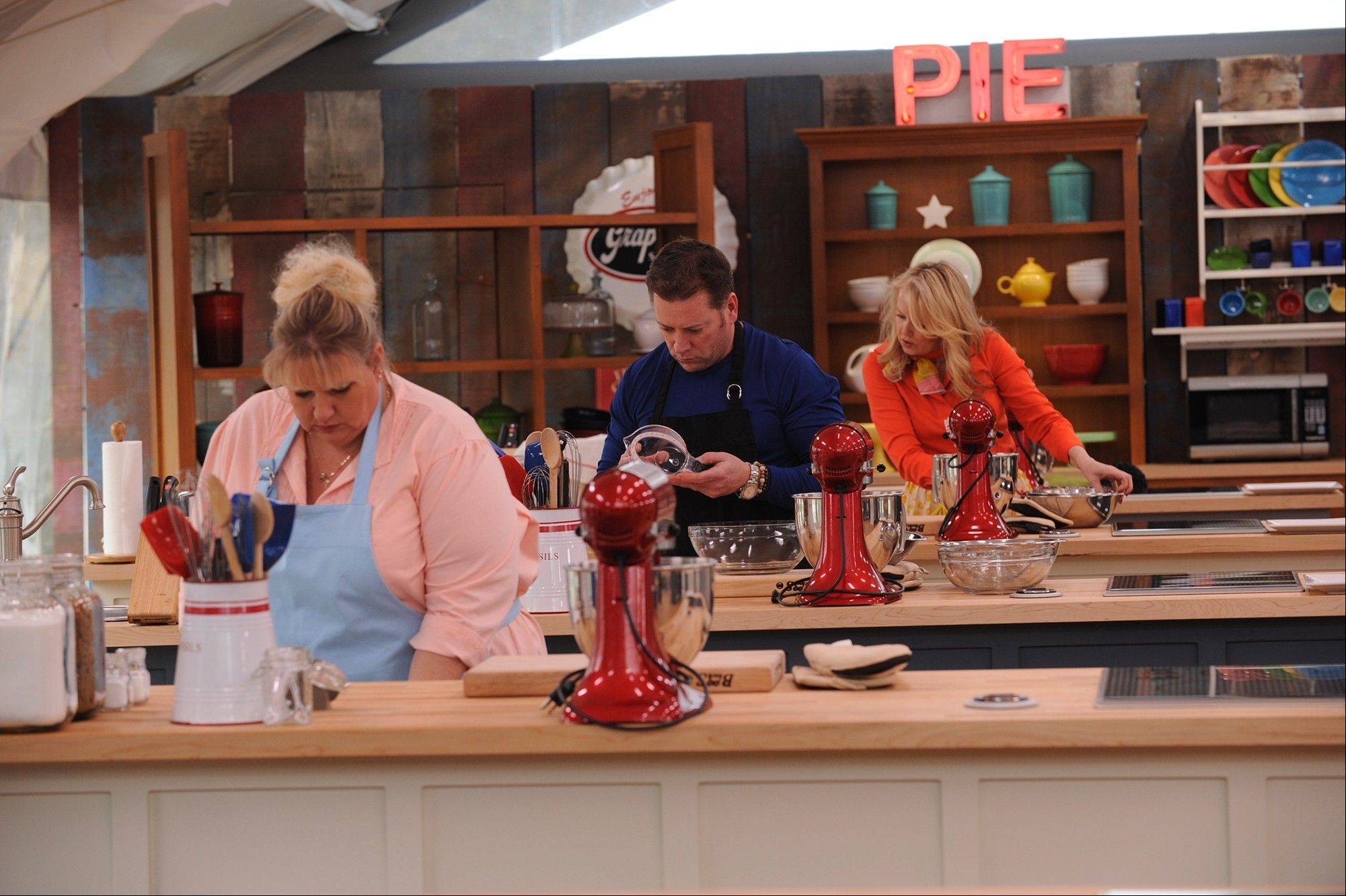 "Brian Emmett, center, made it to the top three and then won CBS's ""The American Baking Competition."""