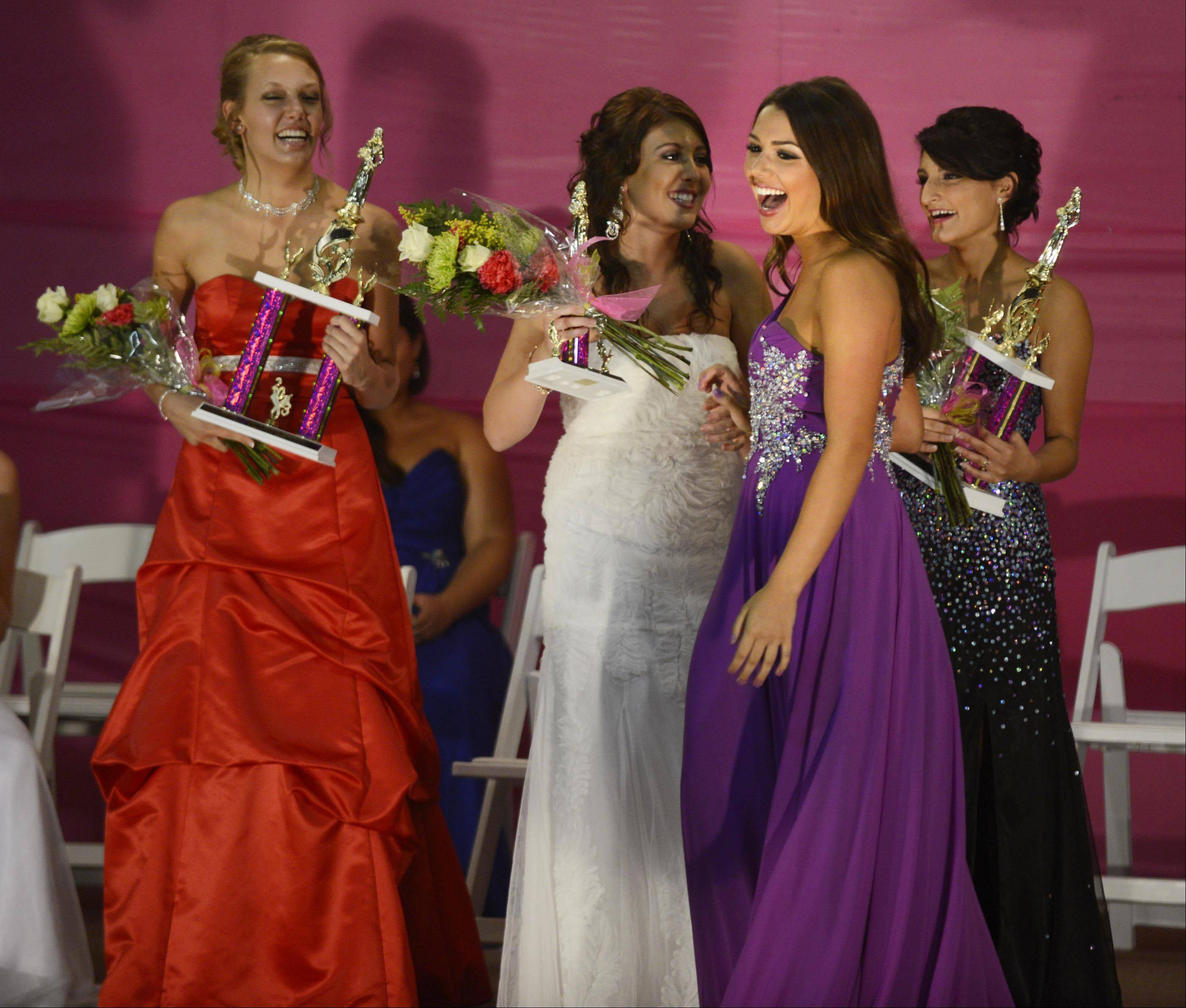 Savannah Kleiner, 18, of Lake in the Hills, reacts as she wins the crown of McHenry County Queen 2013 Wednesday night in Woodstock. Behind her are first runner-up Jessica Thuma, 21, of Woodstock, left, third runner-up Brooke Romero, 16, of Lake in the Hills, middle, and second runner-up Arlinda Fasliu, 18, of Woodstock.