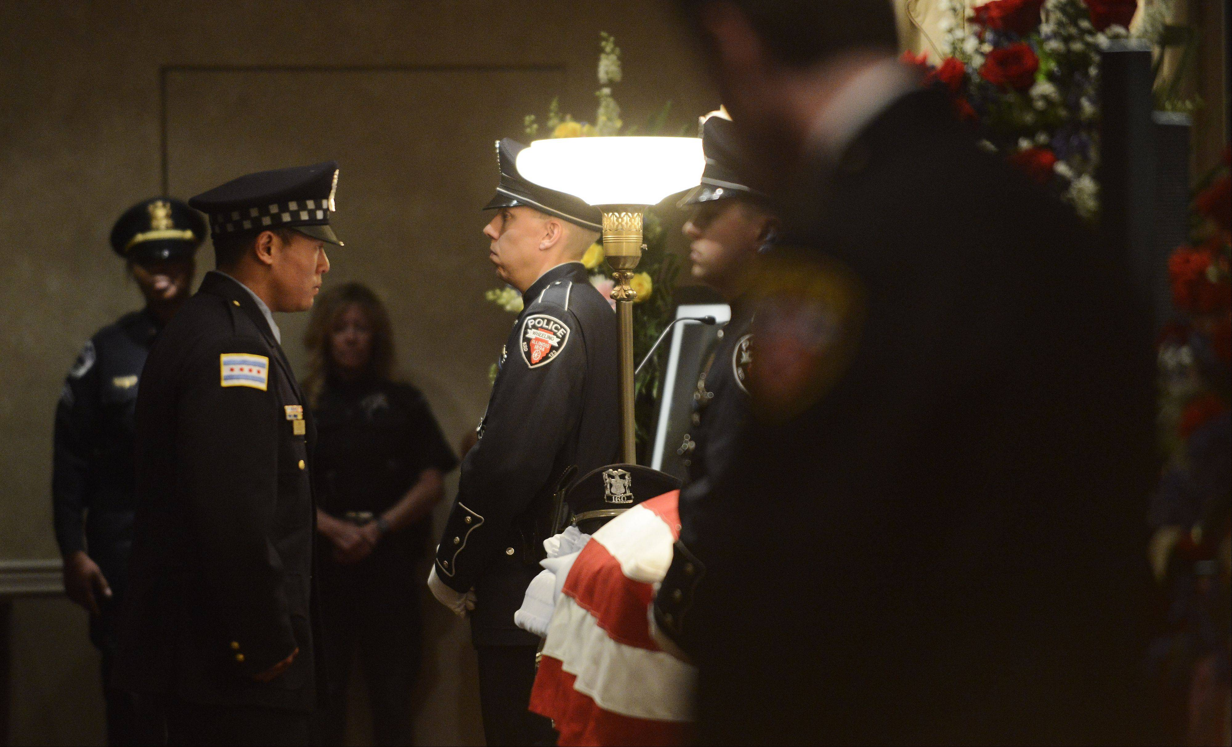 Officers from police departments throughout the greater Chicago area pay their respects during the wake for Wheeling police officer Shamekia Goodwin-Badger at Kolssak Funeral Home in Wheeling Wednesday.