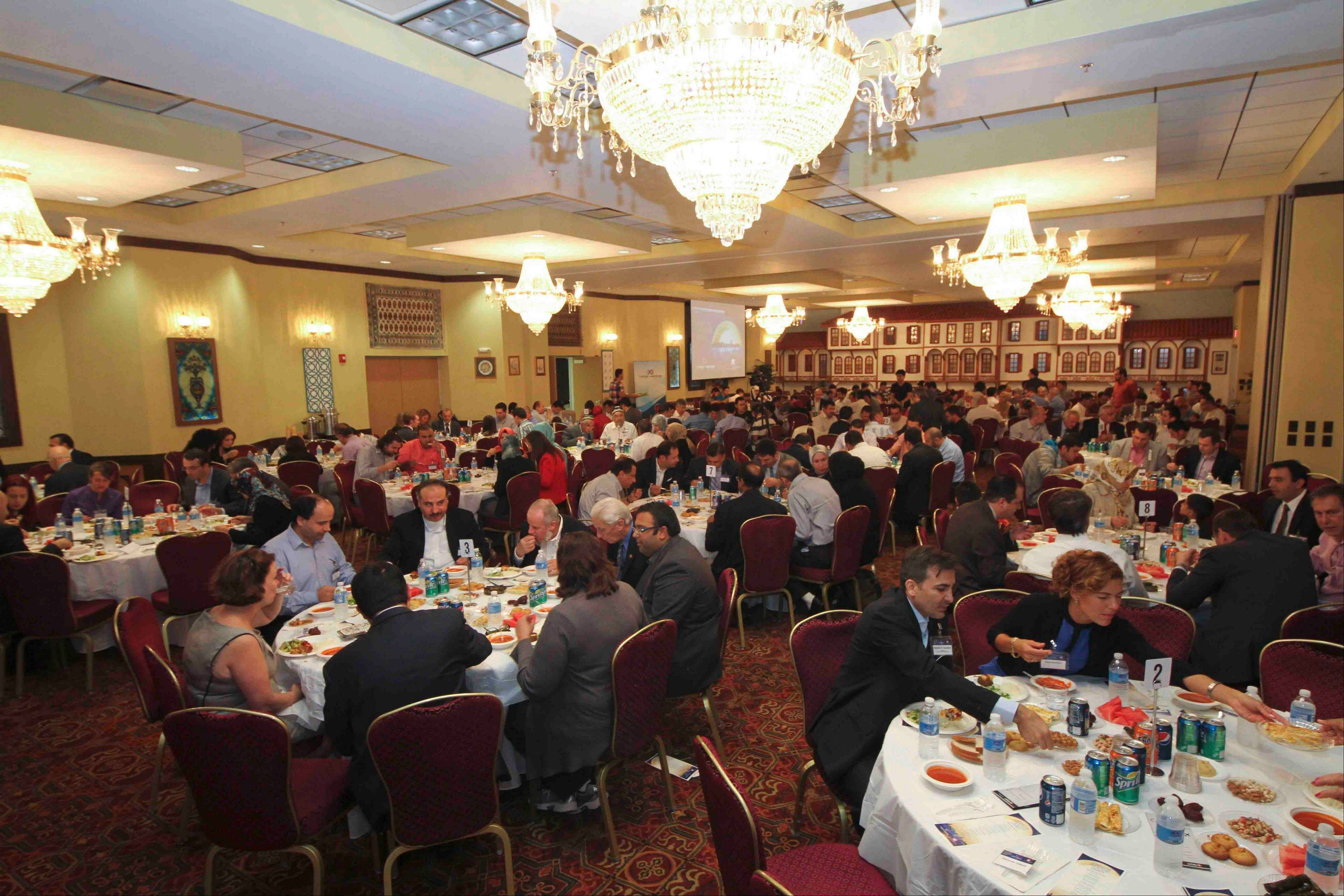 "Community members from various backgrounds gather for a Ramadan Iftar ""Friendship Dinner"" in Mount Prospect, held by the Turkish American Federation of Midwest and the Turkish Chamber of Commerce."