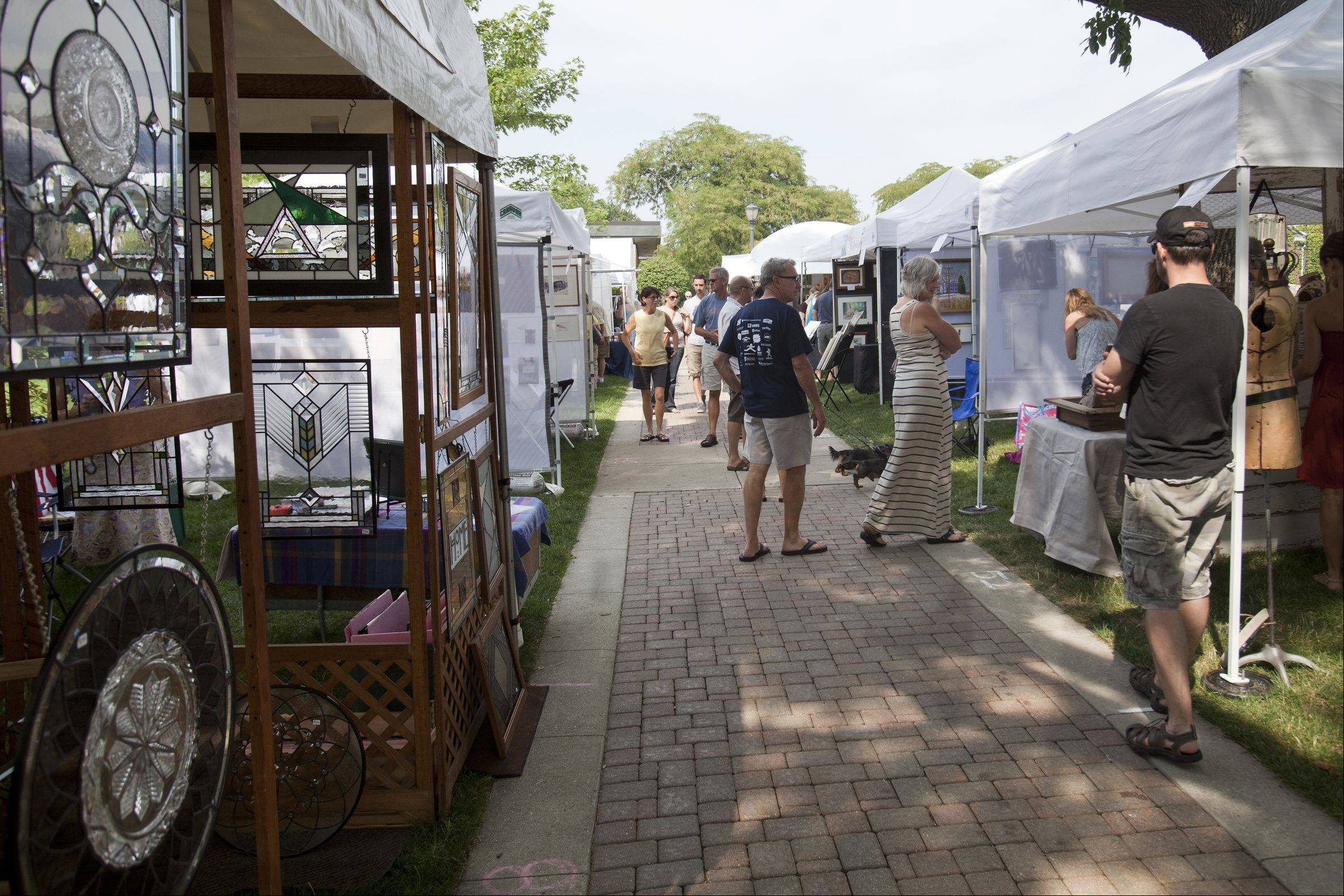 People wander the art tents during the annual David Adler Festival of the Arts. The 33rd annual event will be held this weekend in downtown Libertyville.