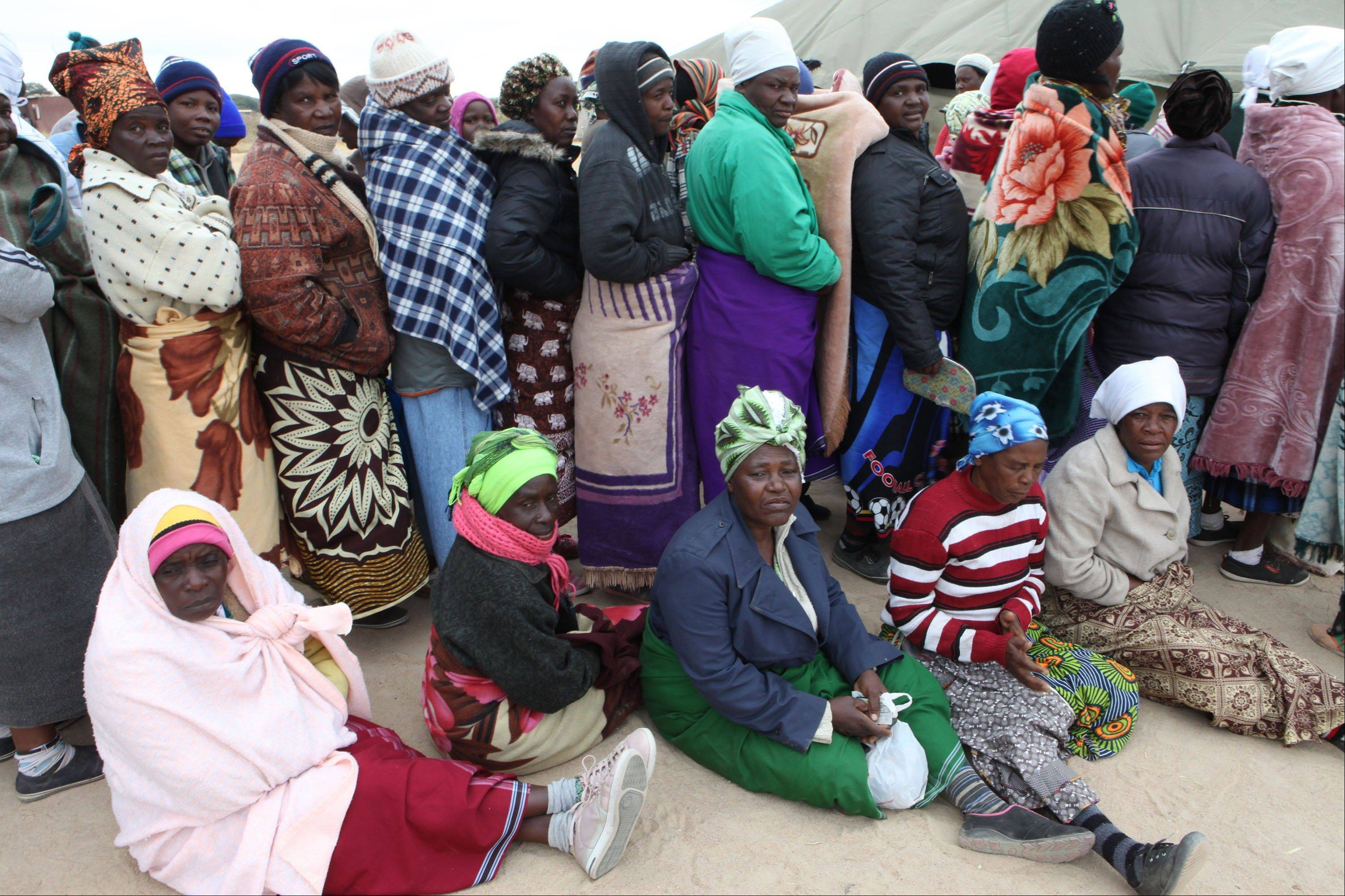 Zimbabweans wait to cast their vote in Presidential and parliamentary elections in the Southern African Nation in Harare, Wednesday.