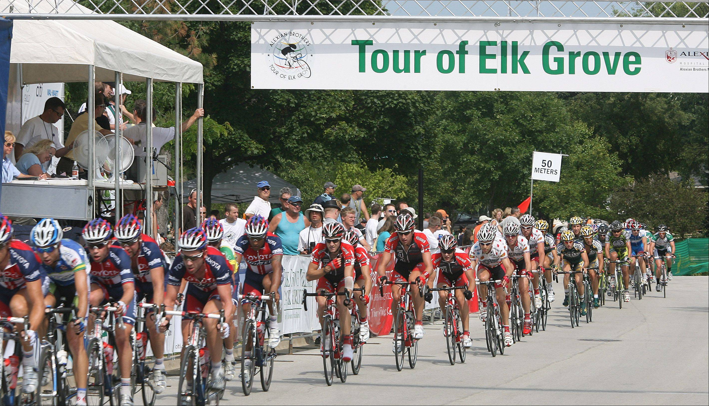 Professional riders race through the streets during Stage 3 of the Tour of Elk Grove.