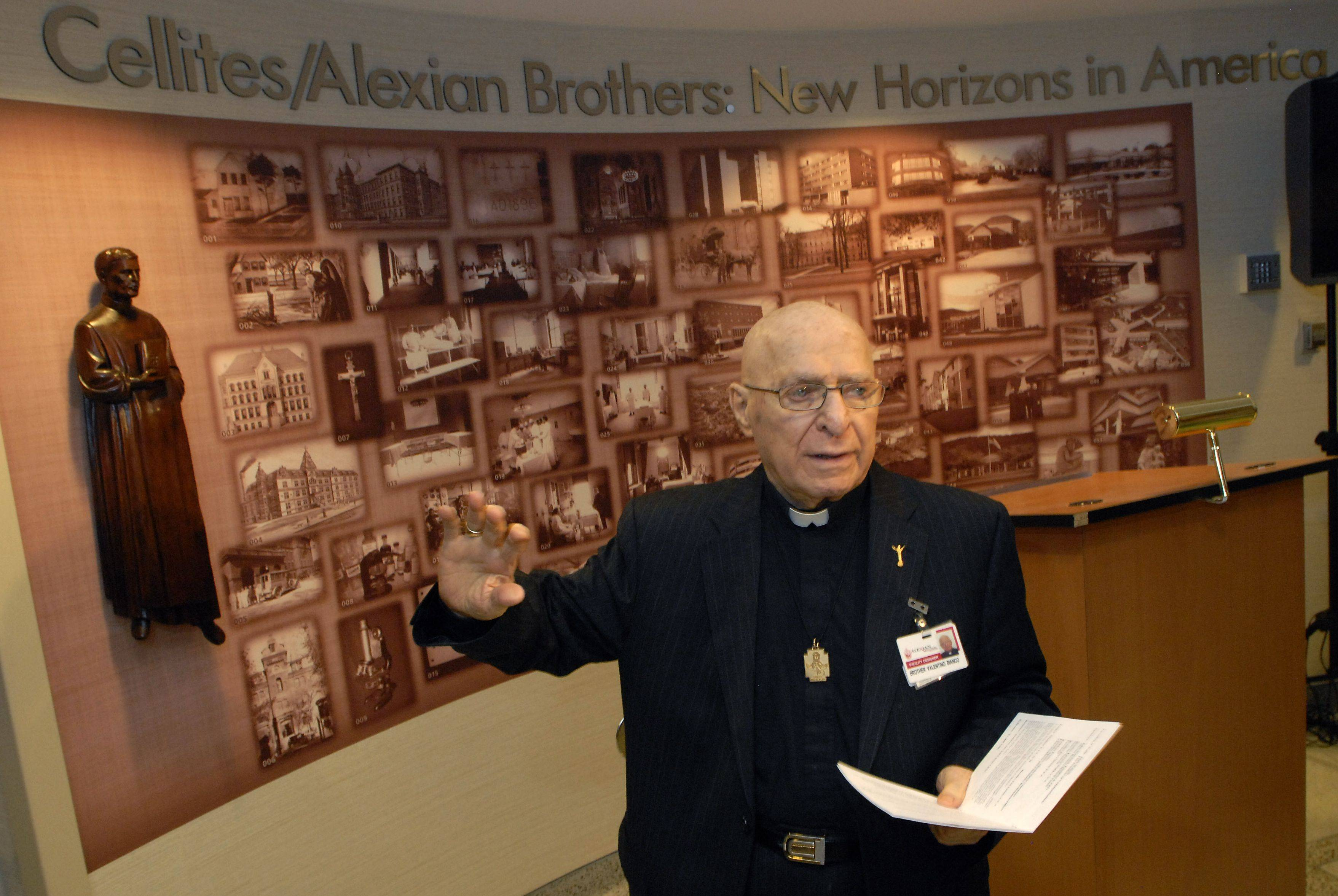 Brother Valentino Bianco directs the unveiling of a historical exhibit at Alexian Brothers Medical Center in Elk Grove Village in March 2011.
