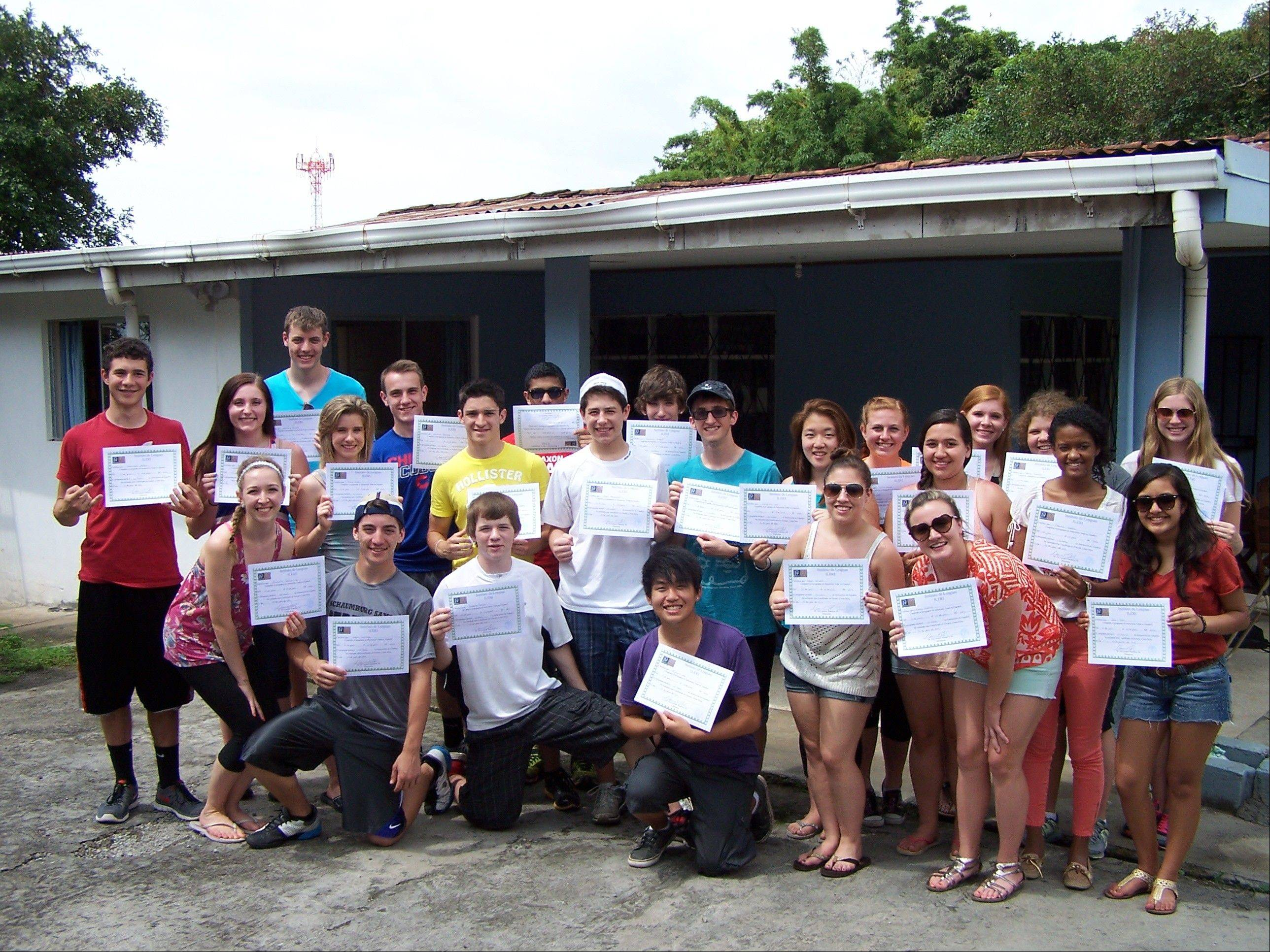 Students from Schaumburg High School traveled to Escazu, Costa Rica, in June. They display the diplomas they received after completing five days of Spanish immersion language classes while living with local families.