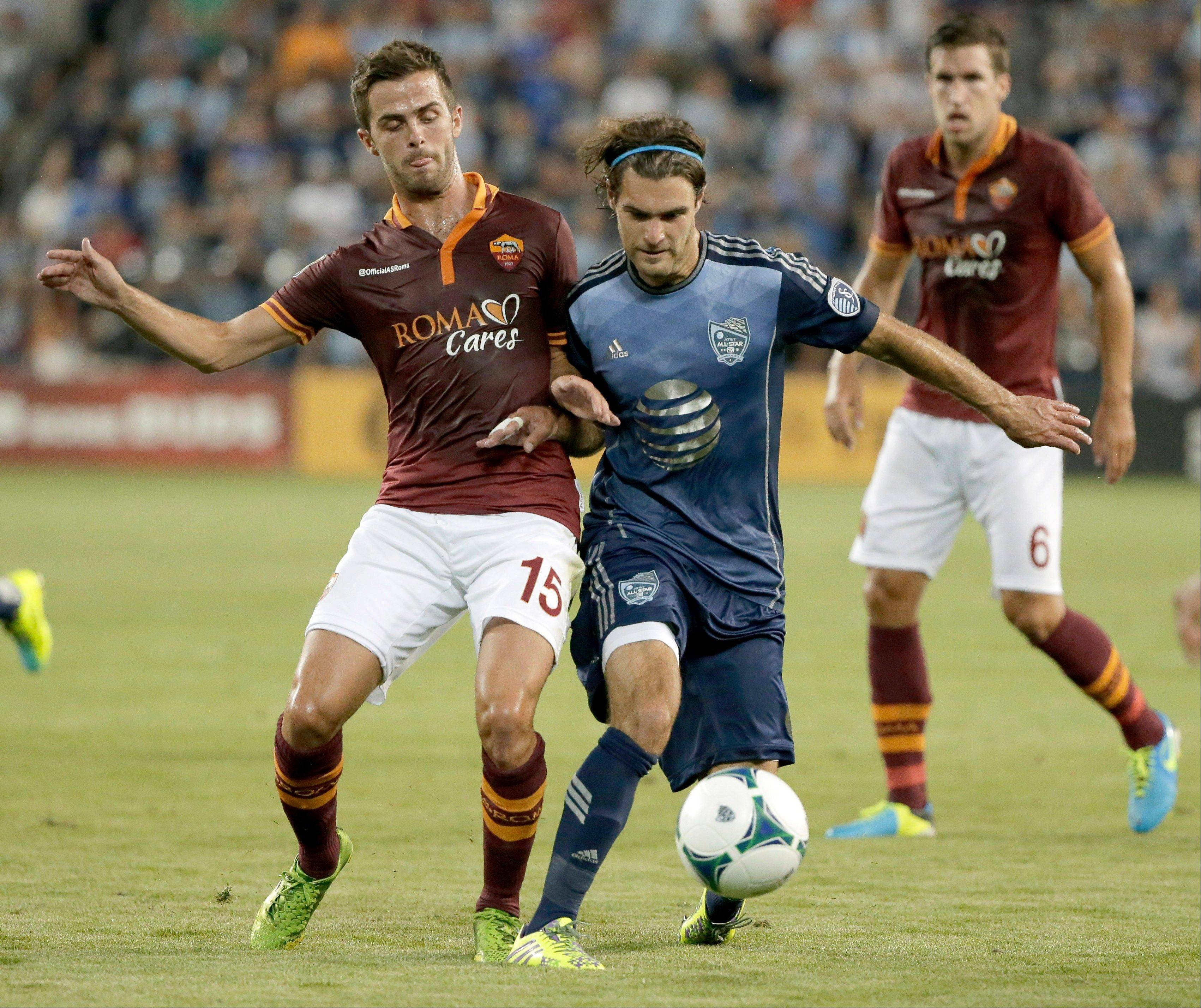 AS Roma midfielder Miralem Pjanic (15) and MLS All-Stars forward Graham Zusi (8) battle for the ball Wednesday during the MLS All-Star soccer game in Kansas City, Kan.