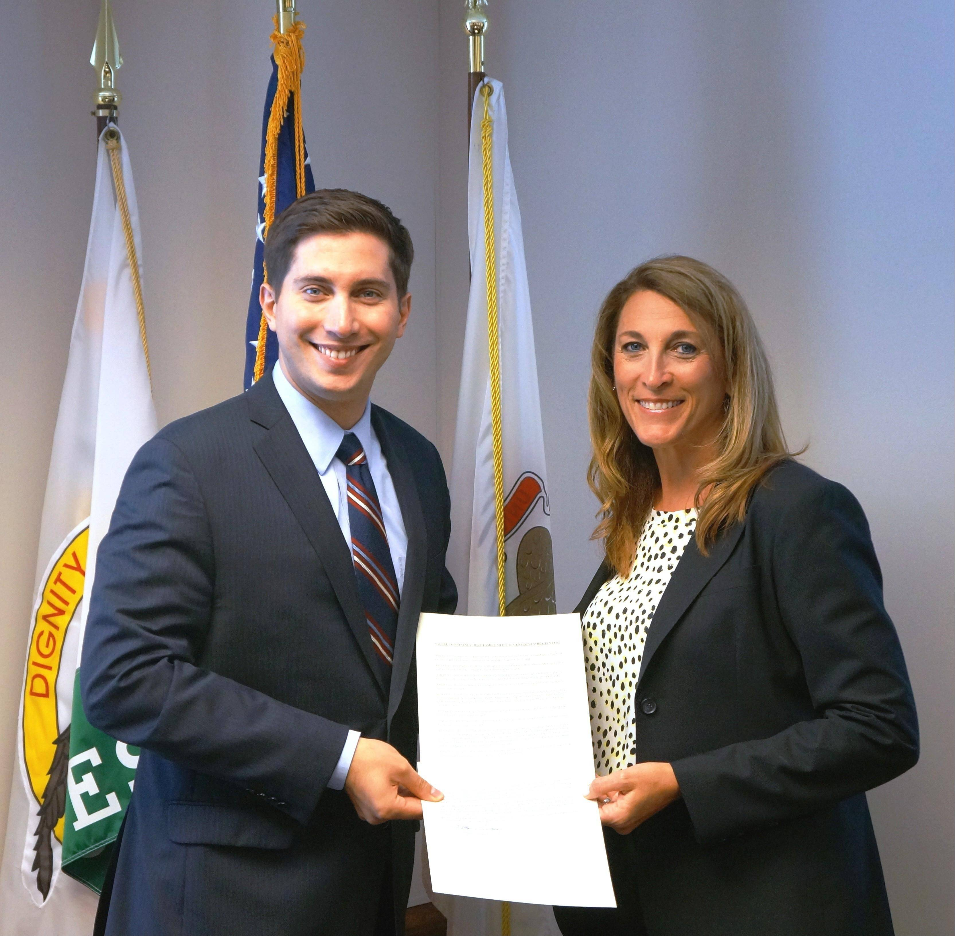 Des Plaines Mayor Matthew Bogusz officially proclaimed Saturday, Aug. 3, Presence Holy Family Fun Fest Day in Des Plaines, by presenting an official proclamation to Holy Family CEO Pam Bell.