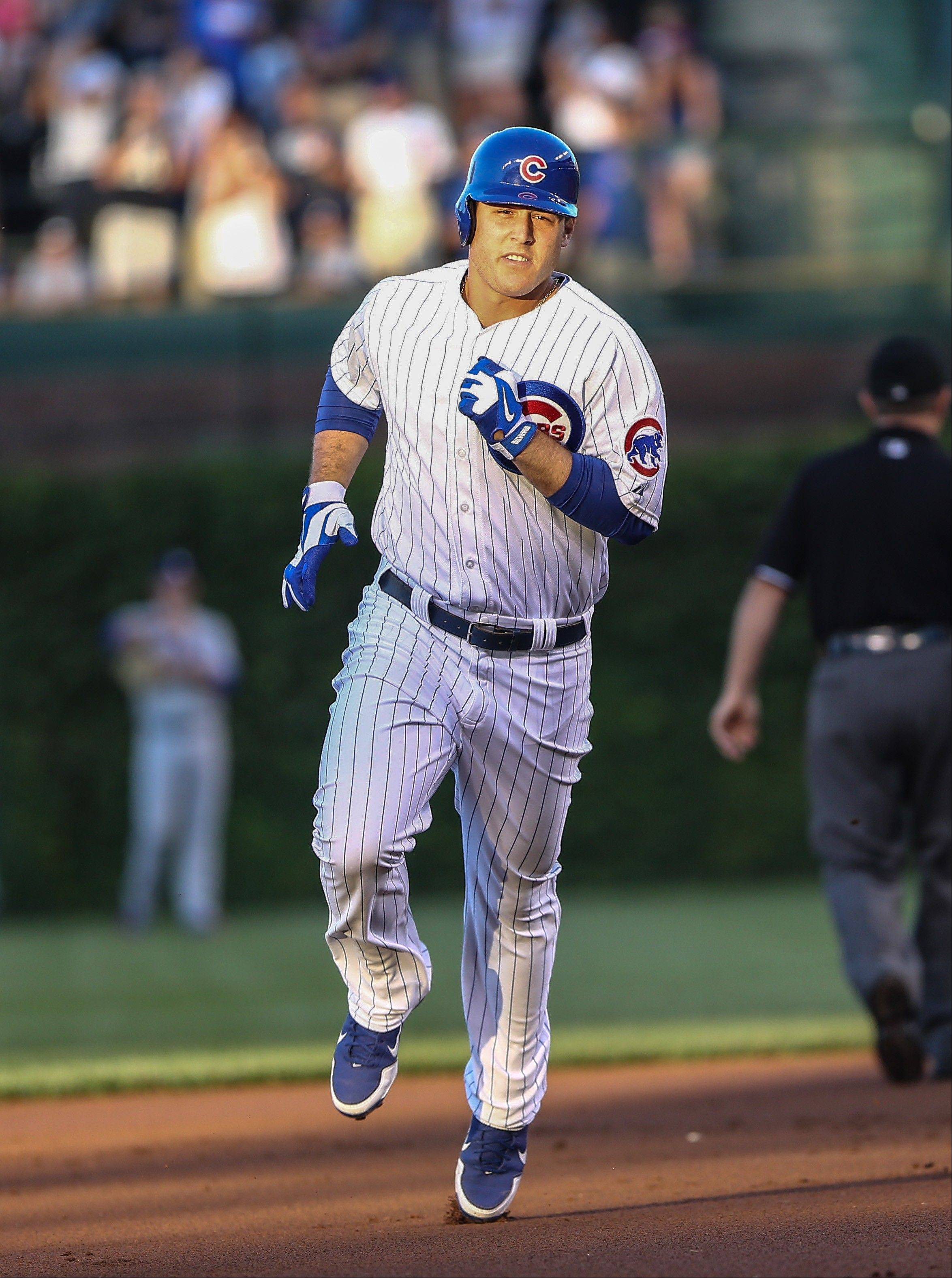 Chicago Cubs' Anthony Rizzo runs the bases after hitting a solo home run in the first inning against the Los Angeles Dodgers in a baseball game in Chicago on Thursday, Aug. 1, 2013. (AP Photo/Charles Cherney)