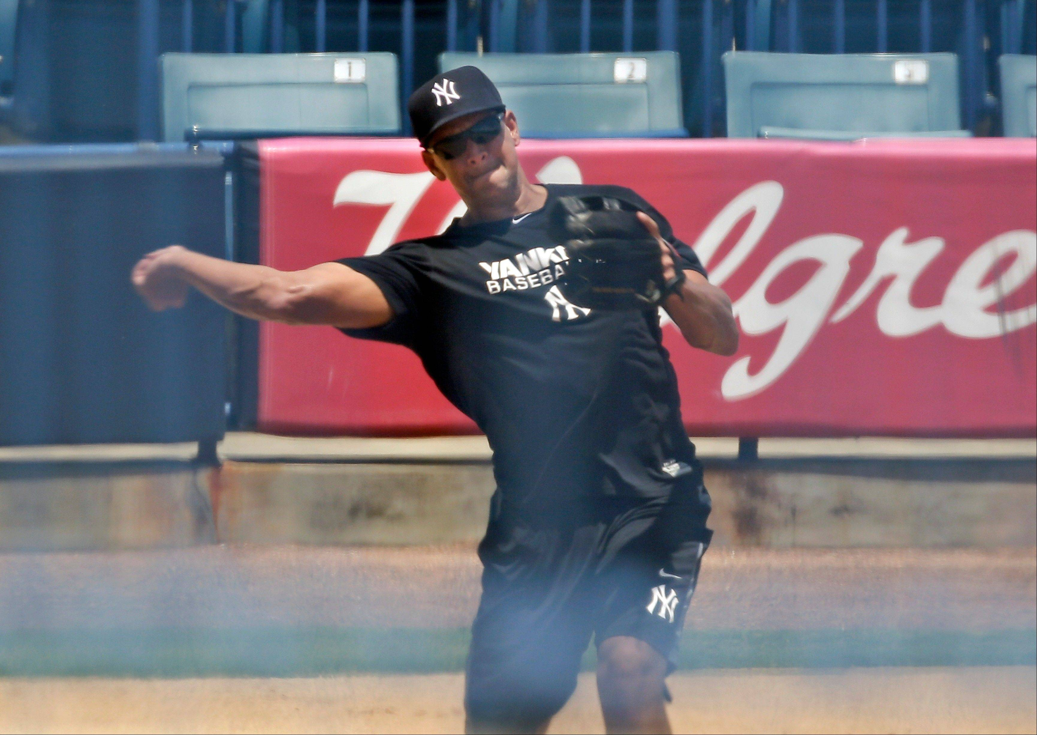 New York Yankees third baseman Alex Rodriguez throws the ball during a rehabilitation workout at Steinbrenner Field Thursday, Aug. 1, 2013, in Tampa, Fla. Major League Baseball is threatening to kick A-Rod out of the game for life unless the New York star agrees not to fight a lengthy suspension for his role in the sport's latest drug scandal, according to a person familiar with the discussions. The person spoke to The Associated Press on Wednesday, July 31, 2013 on condition of anonymity because no statements were authorized. (AP Photo/Chris O'Meara)