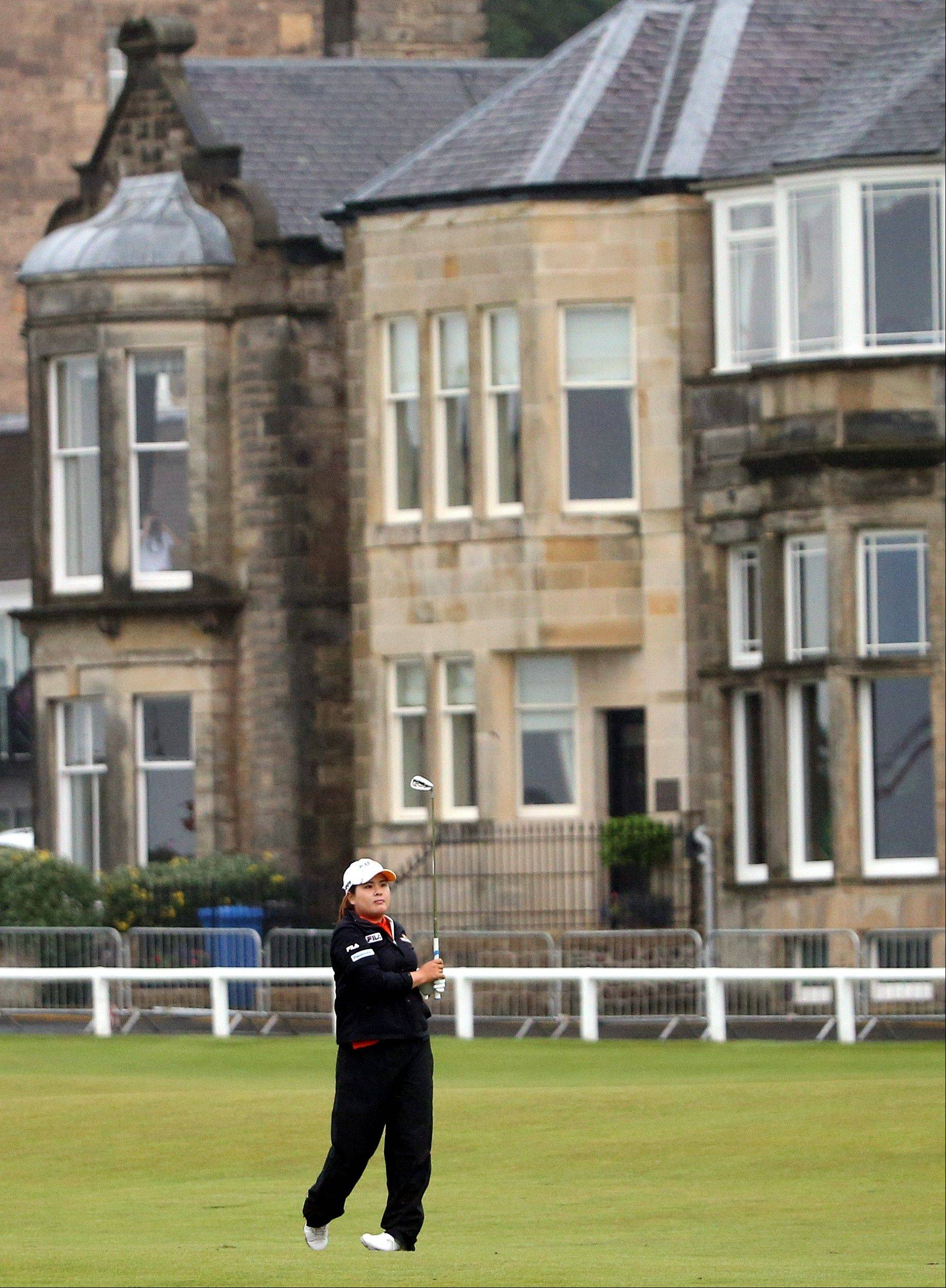 South Korea's Inbee Park watches her shot on the first fairway during the first round of the Women's British Open golf championship on the Old Course at St Andrews, Scotland, Thursday Aug. 1, 2013. (AP Photo/Scott Heppell)