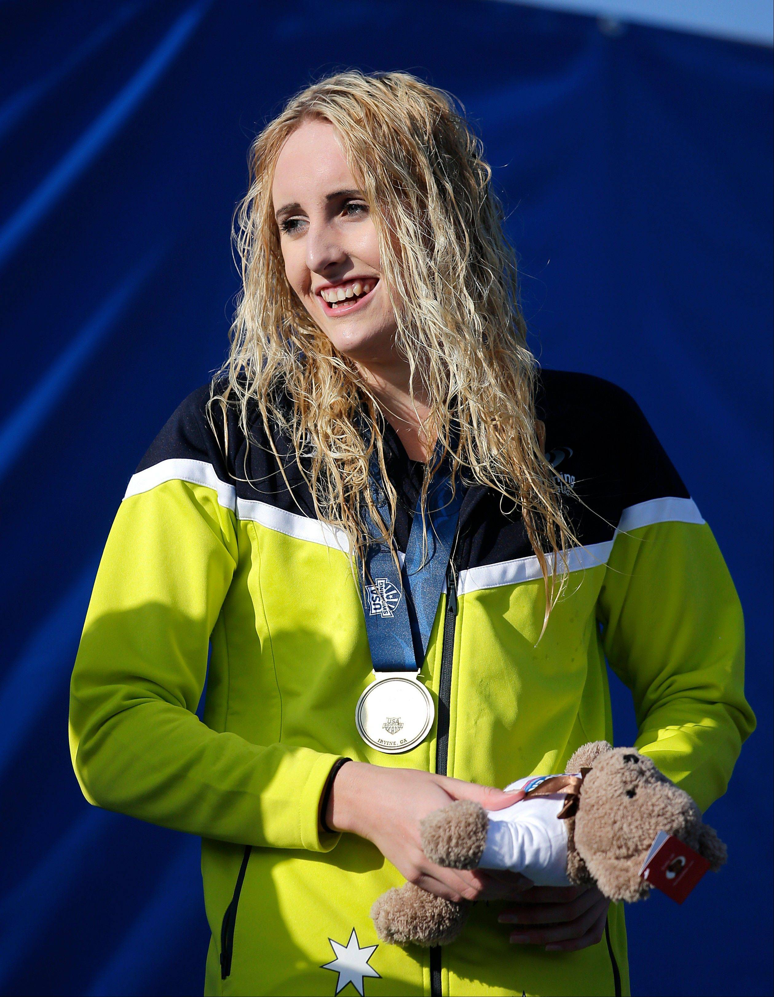 Gold medalist Taylor McKeown, of Australia, smiles during an awards ceremony for the women's 200-meter breaststroke final at the U.S. Open Swimming Championships, Wednesday, July 31, 2013, in Irvine, Calif. (AP Photo/Jae C. Hong)