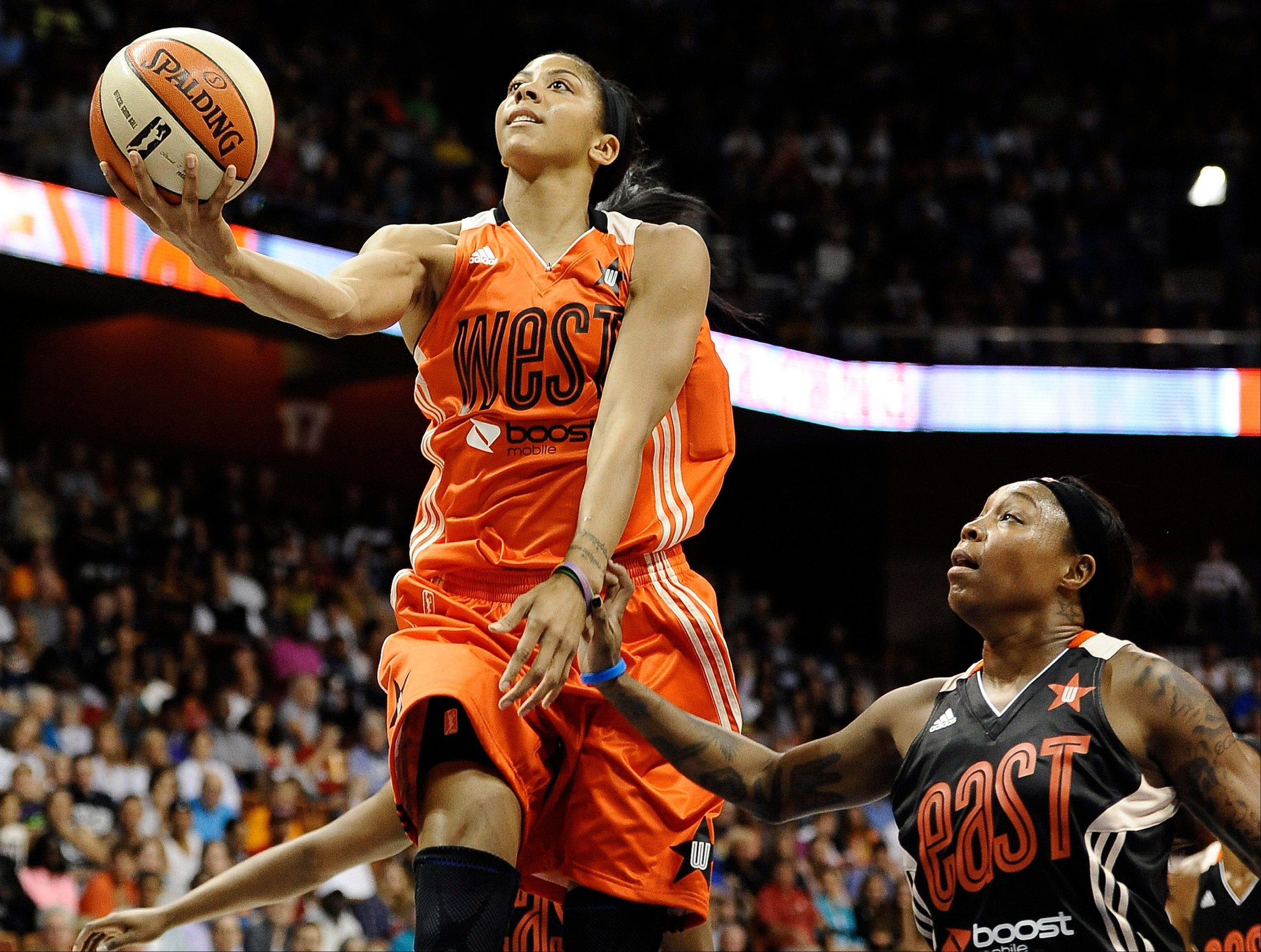West's Candace Parker, of the Los Angeles Sparks, drives to the basket while guarded by East's Cappie Pondexter, of the New York Liberty, during the first half of the WNBA All-Star basketball game in Uncasville, Conn., Saturday, July 27, 2013. (AP Photo/Jessica Hill)