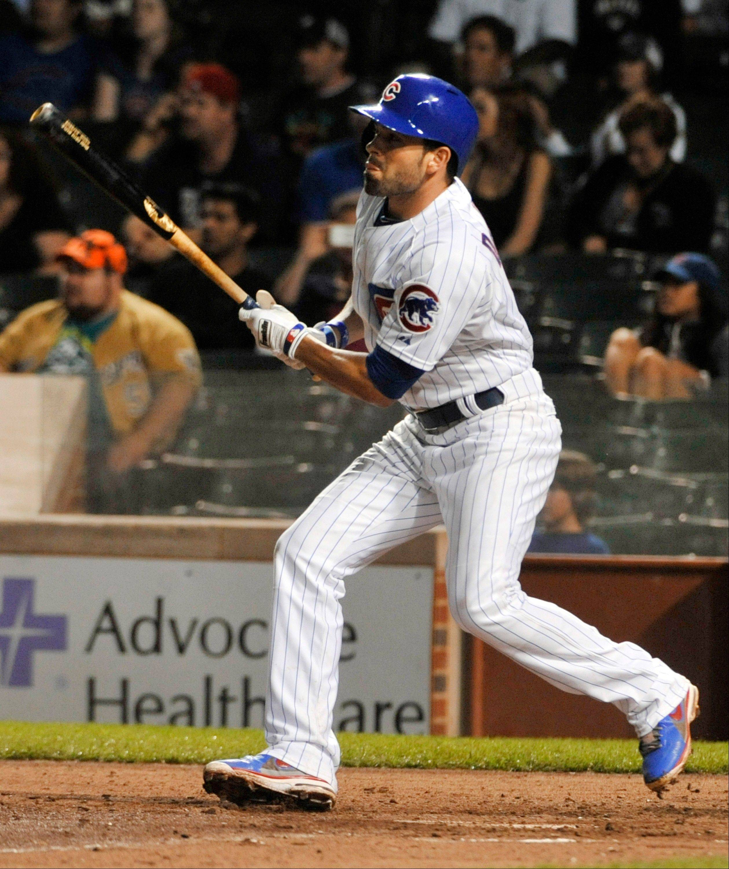 The Cubs' David DeJesus watches his two-run single against the Milwaukee Brewers during Wednesday night's game at Wrigley Field. The Cubs won 6-1.