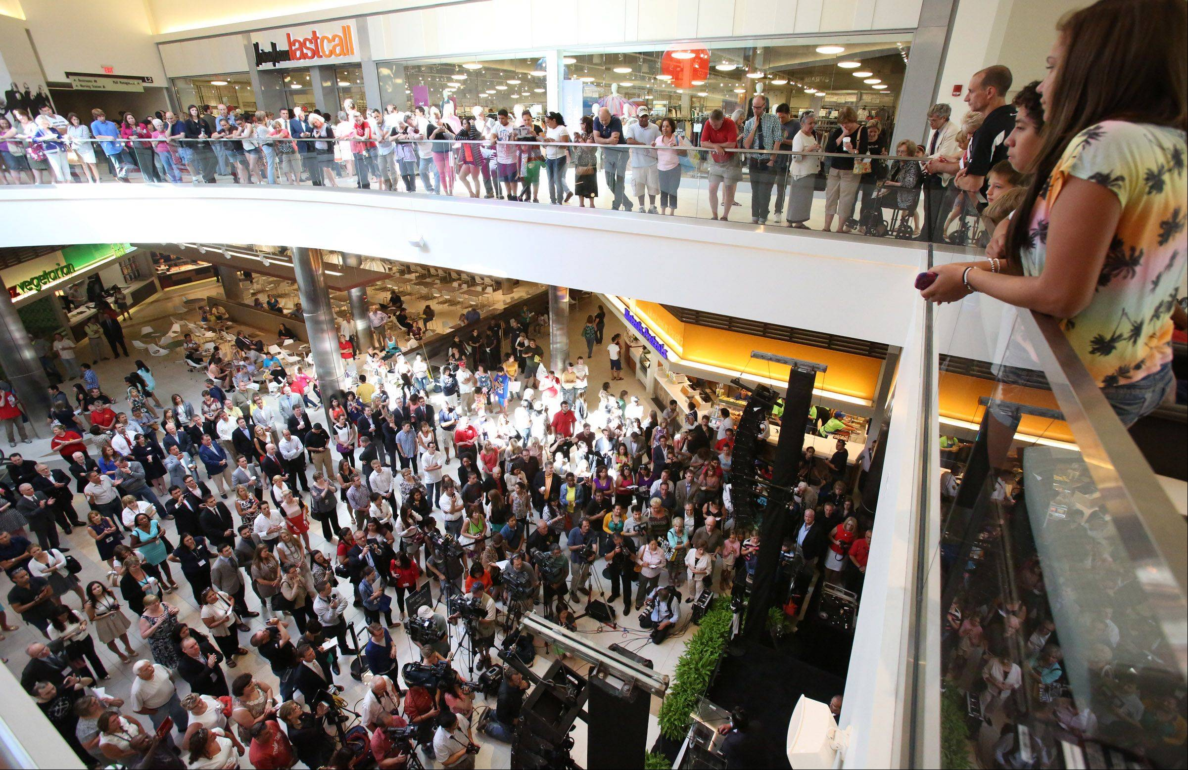 Hundreds of shoppers converge on Rosemont's new upscale Fashion Outlets of Chicago on Thursday for the grand opening and ribbon-cutting ceremony in the food court area on the first level.