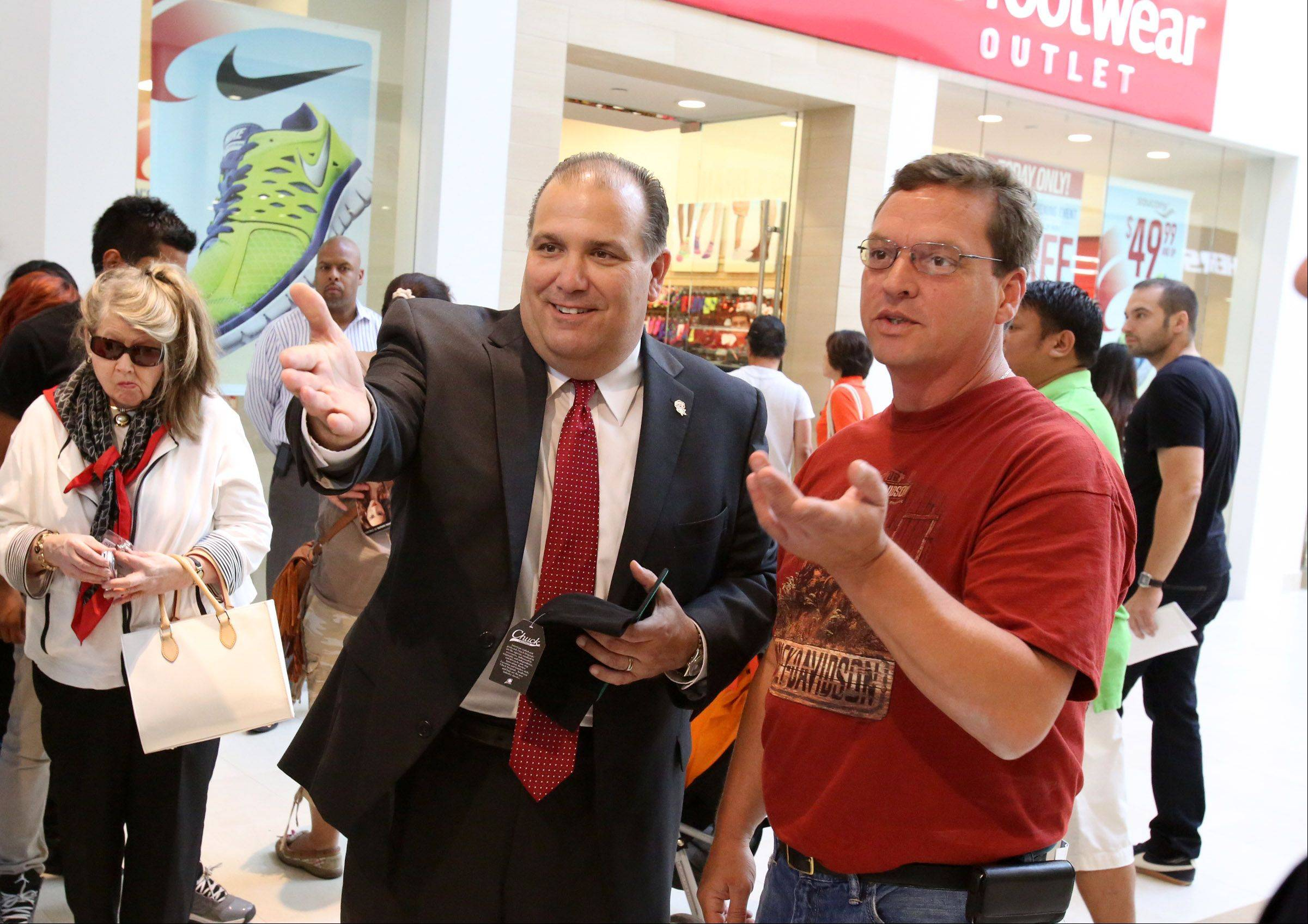 Rosemont Mayor Brad Stephens greets shoppers at the Fashion Outlets of Chicago on Thursday after the ribbon-cutting ceremony.