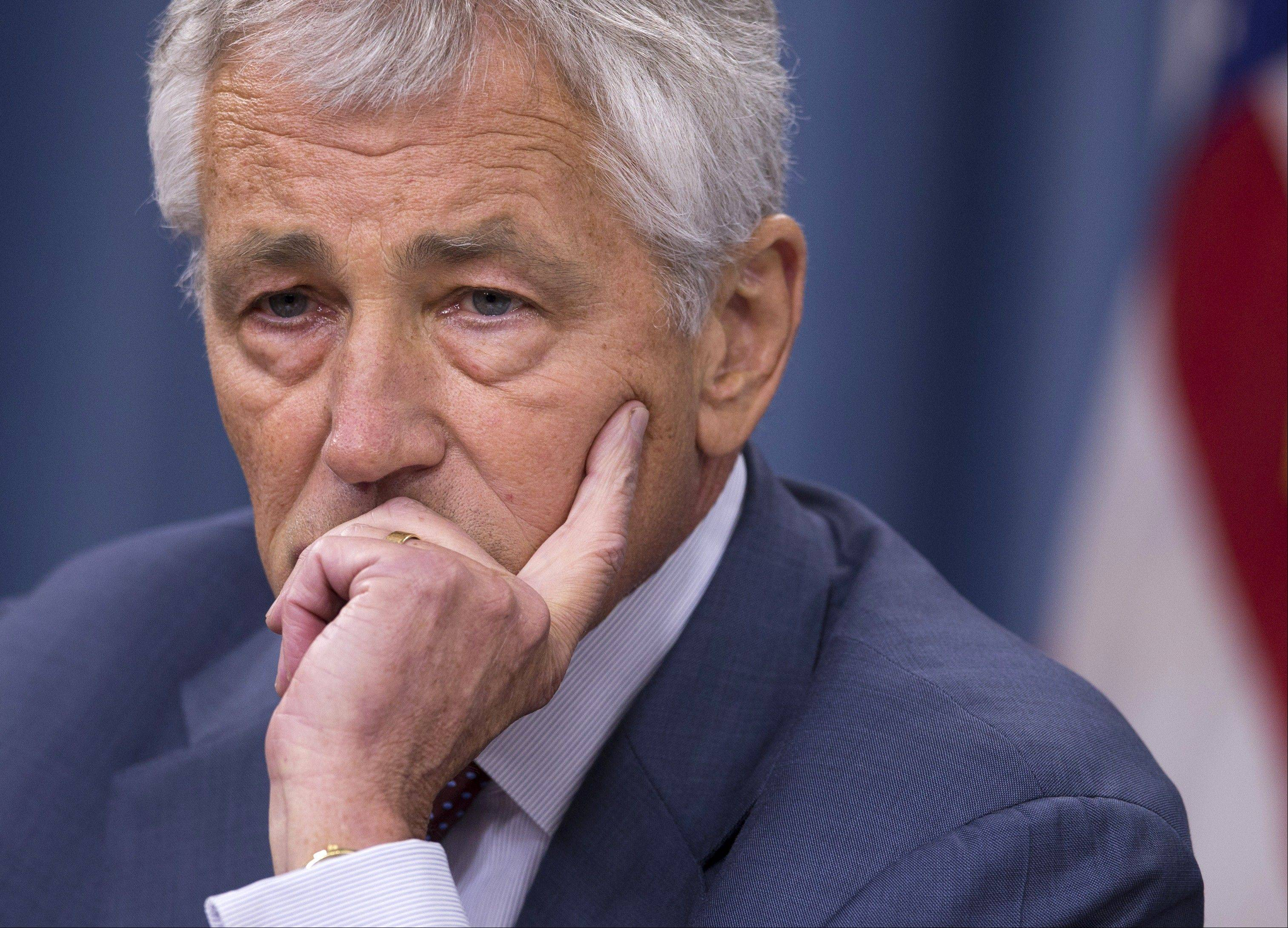 Defense Secretary Chuck Hagel pauses during a news conference at the Pentagon, Wednesday.
