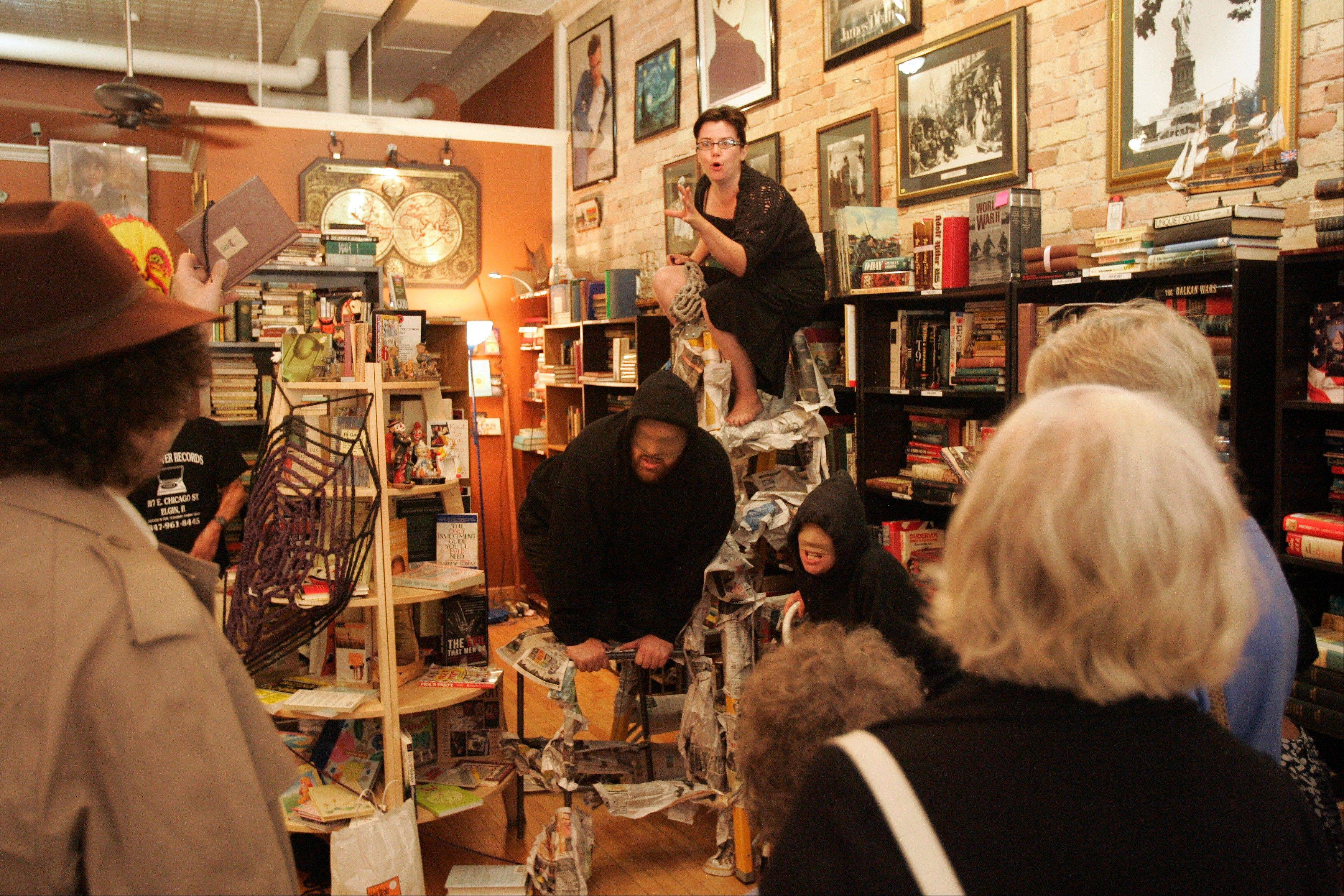 "The Elgin Cultural Arts Commission's ""Walkabout: Theater on Your Feet"" premiered in 2010. Kelly Bolton, on ladder, and others presented ""Oracle"" at a store on Chicago Street."