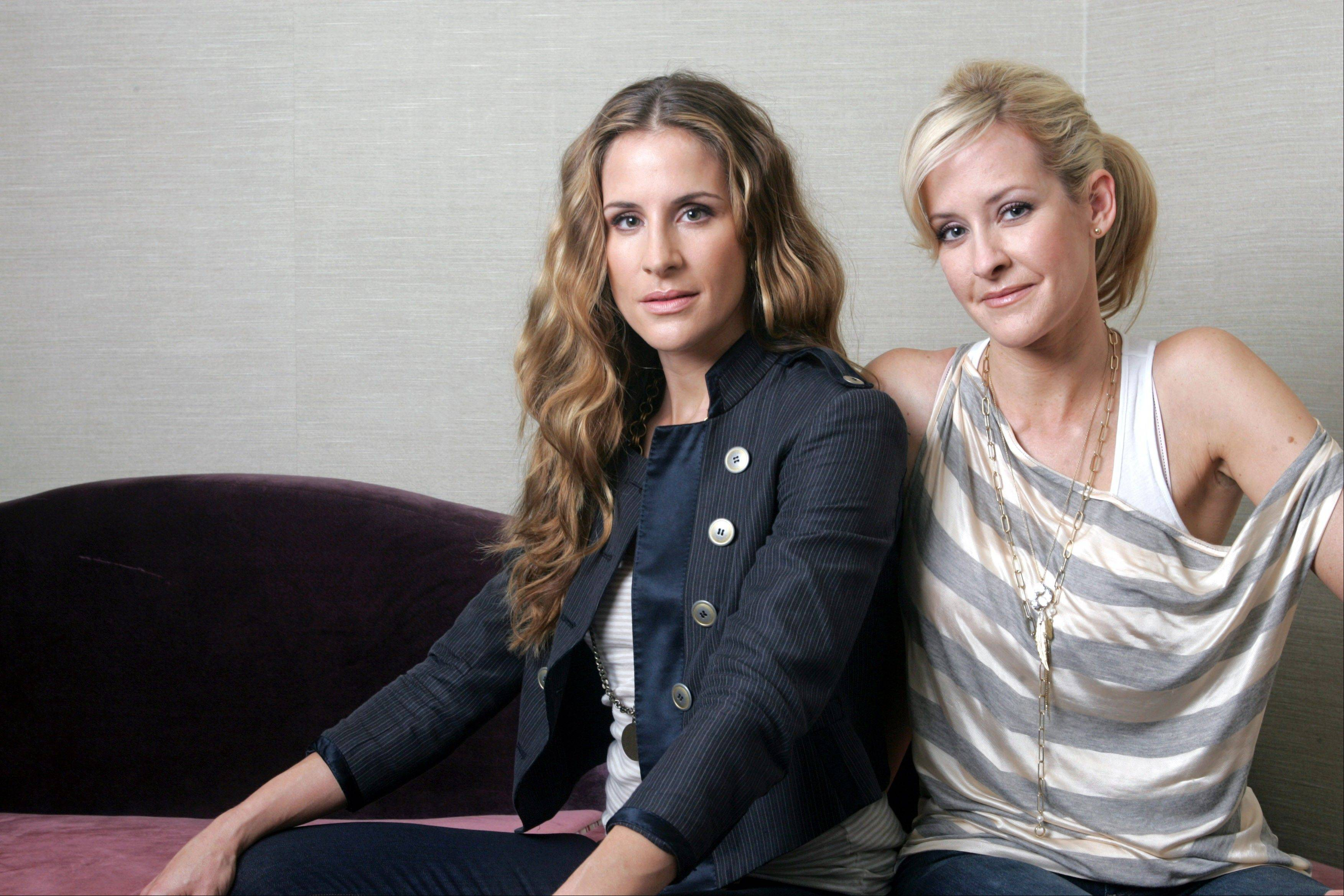Sisters Emily Robison, left, and Martie Maguire of the Court Yard Hounds will perform a Saturday set at the Lollapalooza music festival at Grant Park in Chicago.