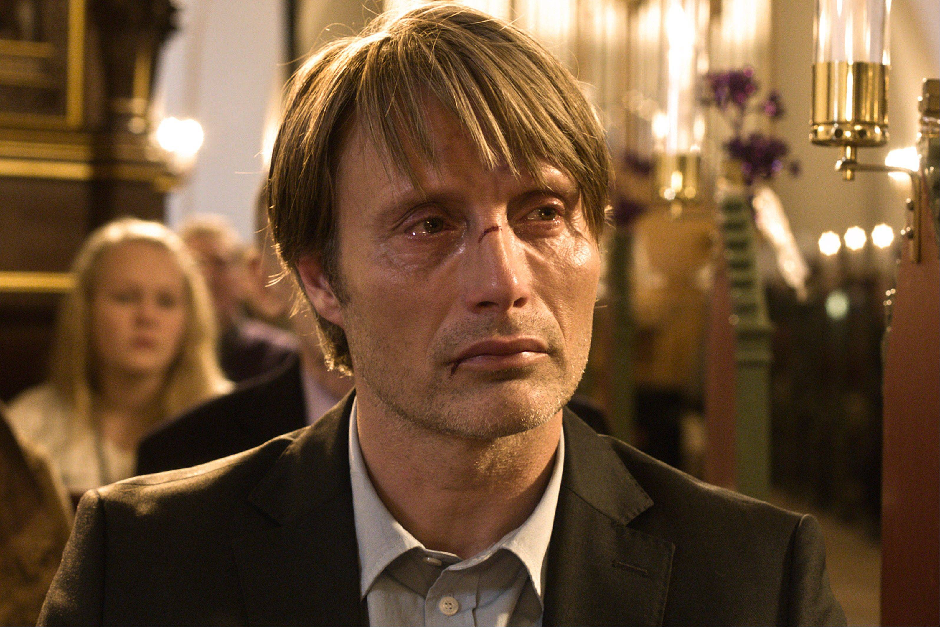 "Lucas (Mads Mikkelsen) fights an invisible force of suspicion and hatred as an innocent man marked by false charges in ""The Hunt."""