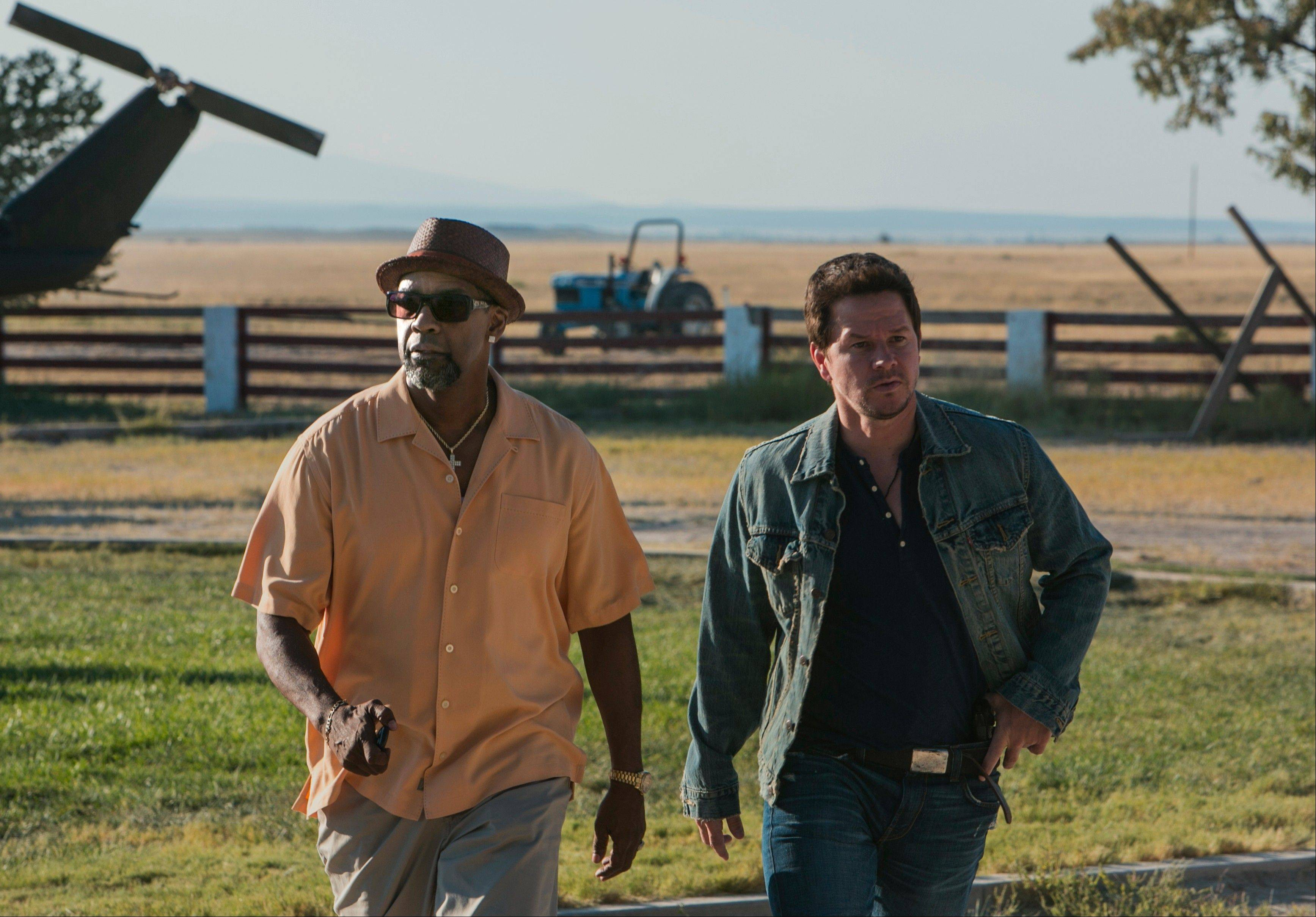 "Trench (Denzel Washington) and Stig (Mark Wahlberg) don't know each is working as an undercover agent for another agency in the R-rated, action-packed comedy ""2 Guns."""