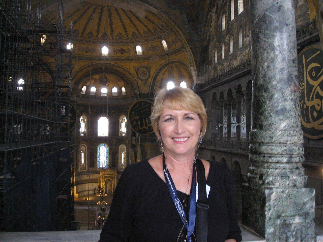 Chris LaRue smiles from the Hagia Sophia, which has gone from a church to a mosque to a museum over the centuries. LaRue, an Elgin High School teacher, created a lesson about sacred spaces after a trip to Turkey this summer.
