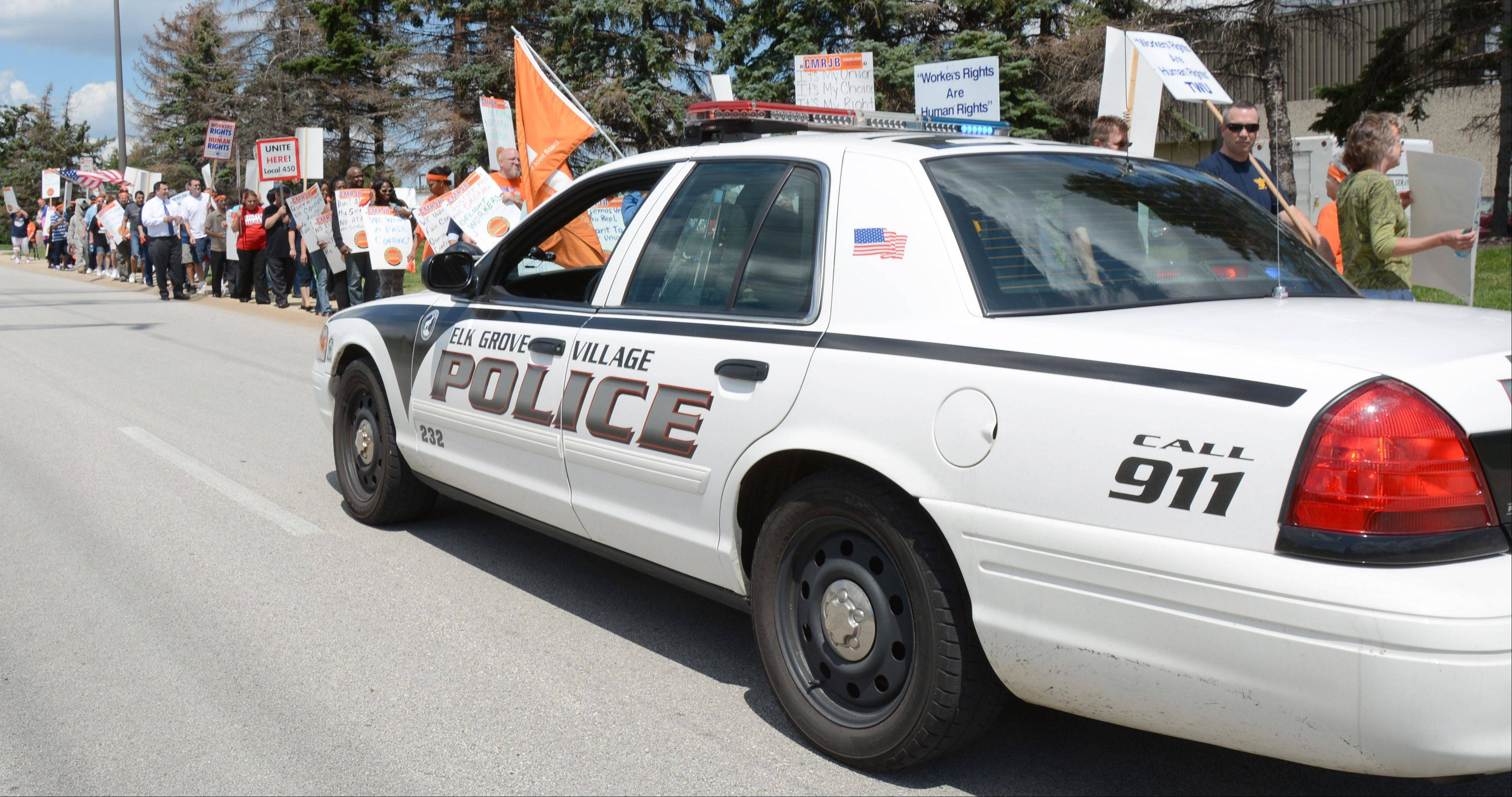 Elk Grove Village police asked protesters to remain on the sidewalk Thursday during a worker rally outside Grecian Delight. Workers are protesting the company's latest contract offer.