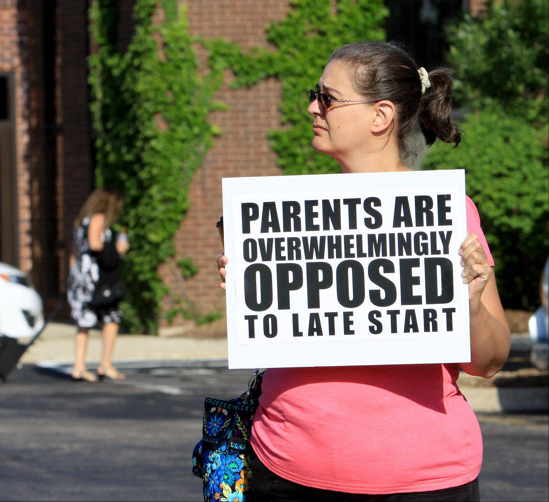 Jill Upadhyaya, a parent from Hoffman Estates, shows her opposition to the late start scheduling option supported by the Palatine Township Elementary District 15 teachers union.