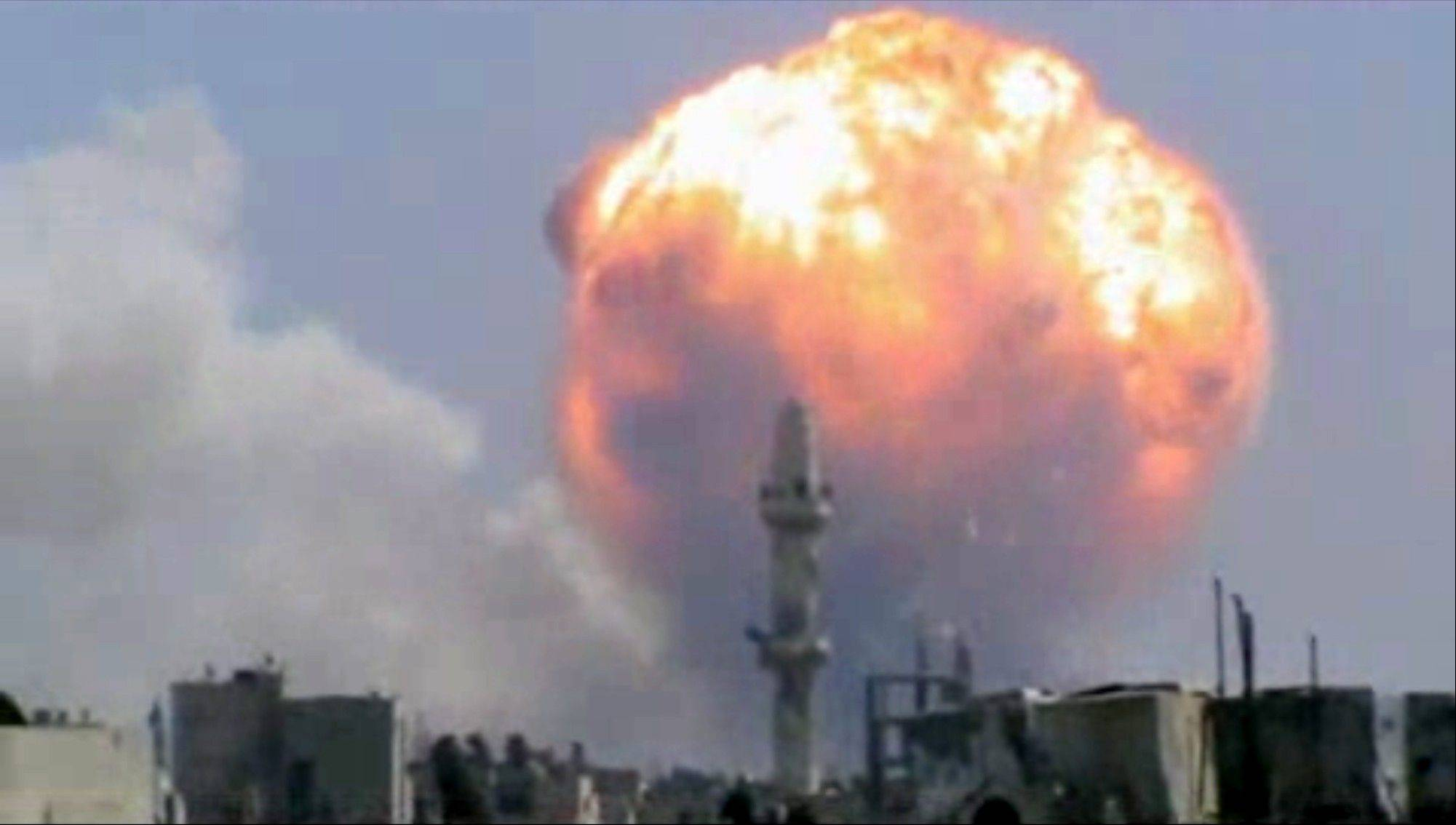 In this image taken from video posted by Ugarit News, which has been authenticated based on its contents and other AP reporting, purports to show a fireball from an explosion at a weapons depot set off by rocket attacks that struck government-held districts in the central Syrian city of Homs on Thursday, Aug. 1, 2013. The blasts sent a massive ball of fire into the sky, killing scores and causing widespread damage and panic among residents, many of whom are supporters of President Bashar Assad.