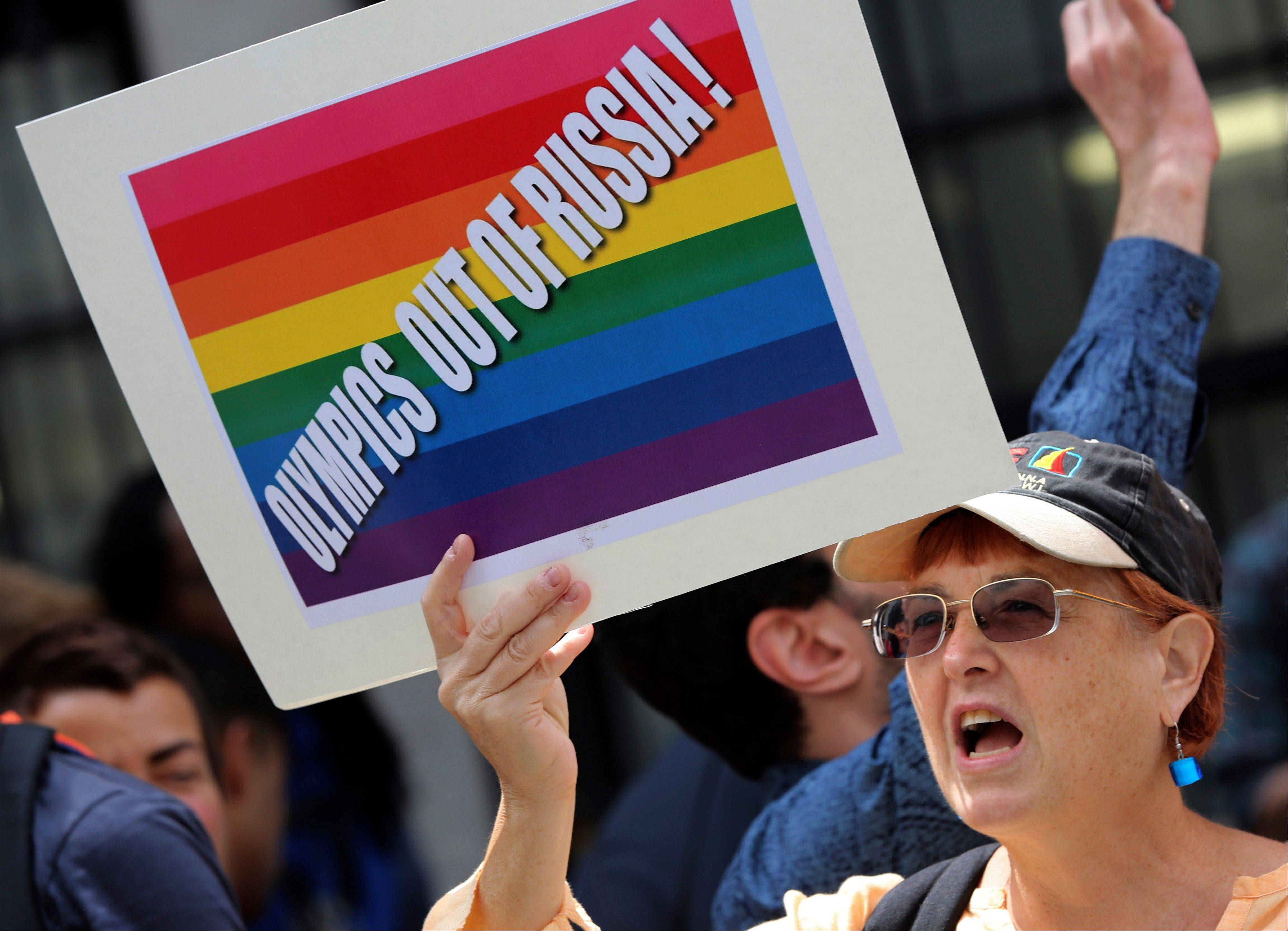 A gay rights activist chant slogans during a demonstration in front of the Russian consulate in New York, Wednesday, July 31, 2013. Russian vodka and the Winter Olympics in Sochi are the prime targets as gays in the United States and elsewhere propose boycotts and other tactics to convey their outrage over Russia's intensifying campaign against gay-rights activism.