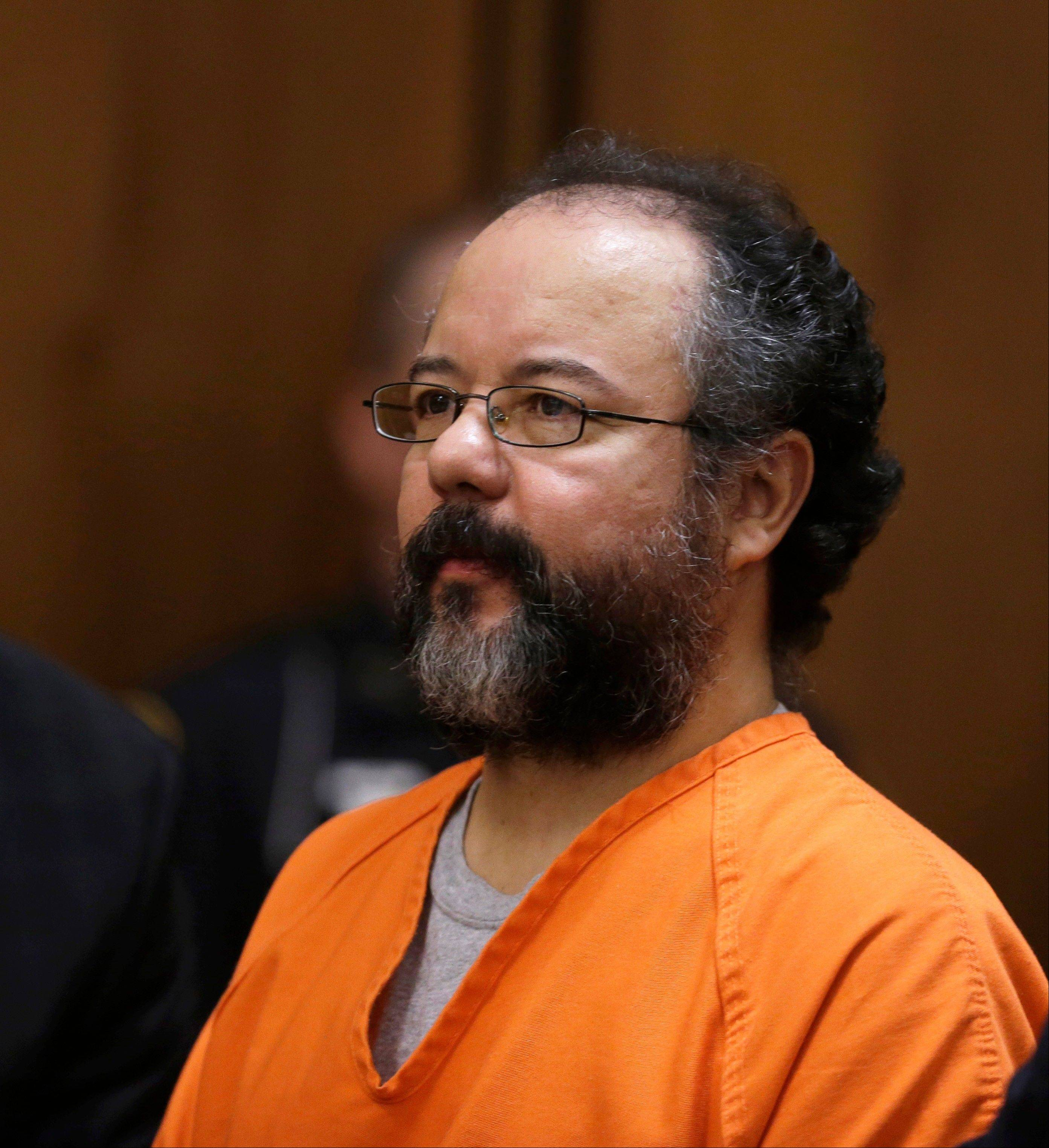 Ariel Castro sits in the courtroom during the sentencing phase Thursday, Aug. 1, 2013, in Cleveland. Three months after an Ohio woman kicked out part of a door to end nearly a decade of captivity, Castro got the life term for the most serious count and was getting additional time for the hundreds of other counts.