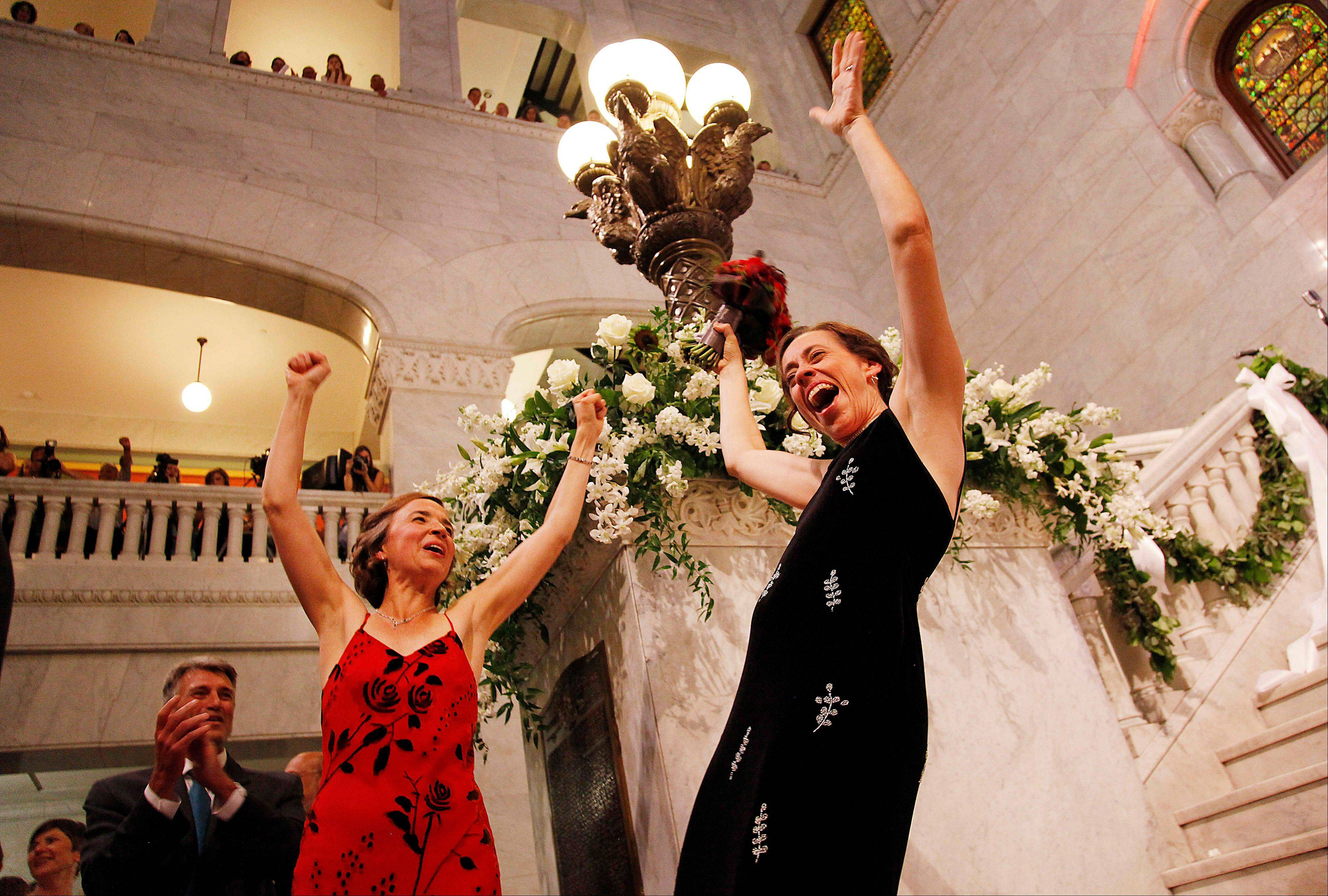Margaret Miles, right, celebrates with wife Cathy ten Broeke, left, after they were married at the Minneapolis Freedom to Marry Celebration, Thursday at the Minneapolis City Hall.