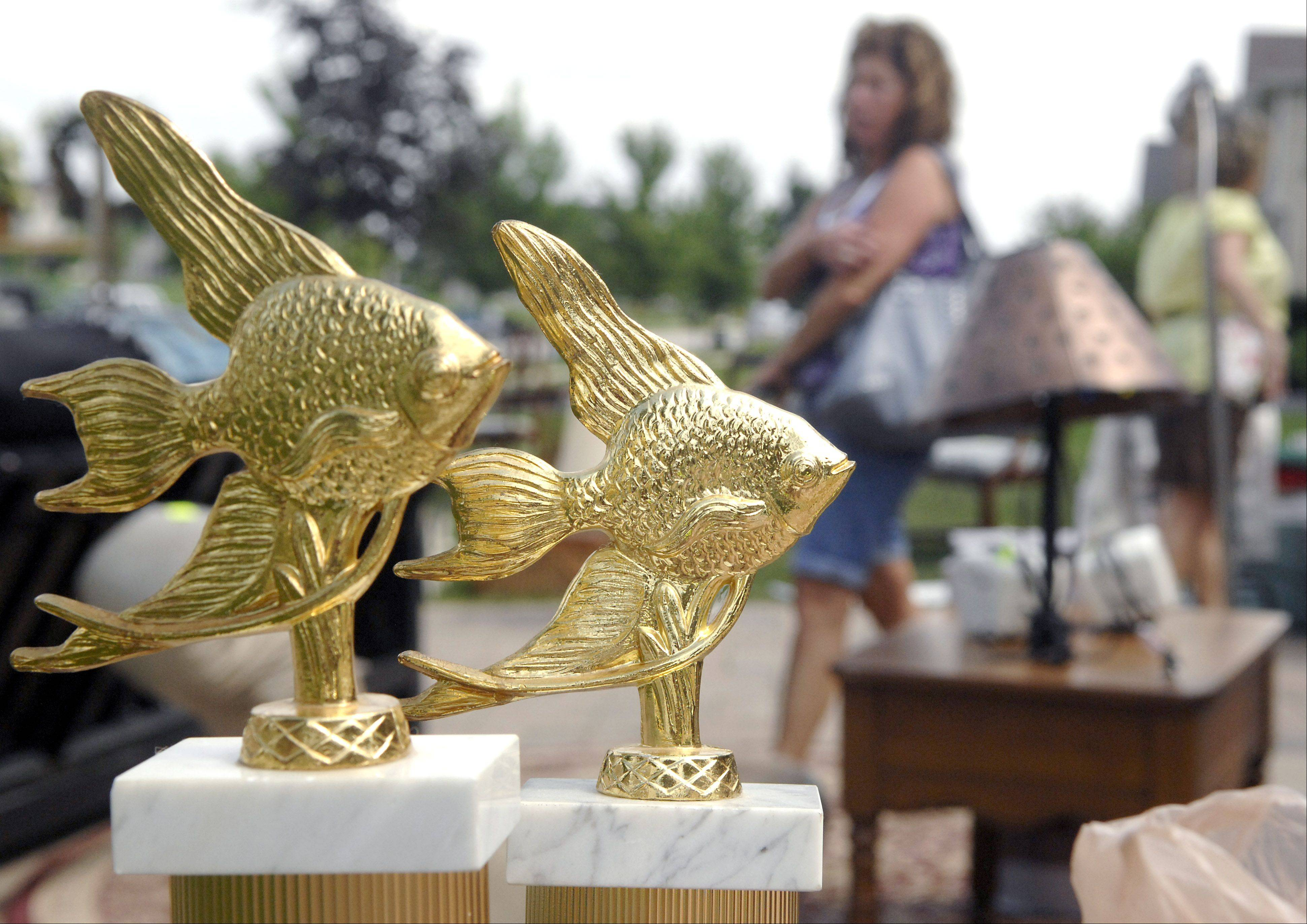 Find some treasures, like these angelfish trophies from two years ago, at the community garage sale Friday and Saturday, held in conjunction with North Aurora Days.