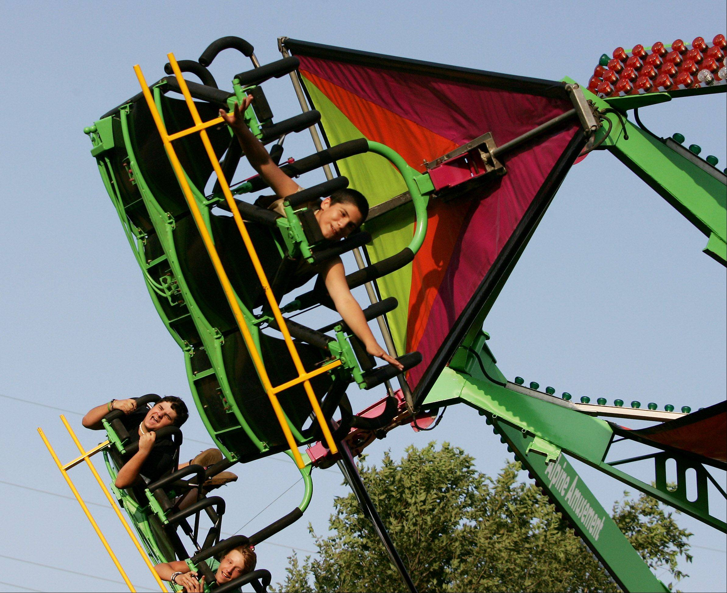 Alfonso Gonzalez, 13, of Lake Villa pretends to fly like Superman on the Cliff Hanger at the 77th Annual Lake Villa Days in 2010.