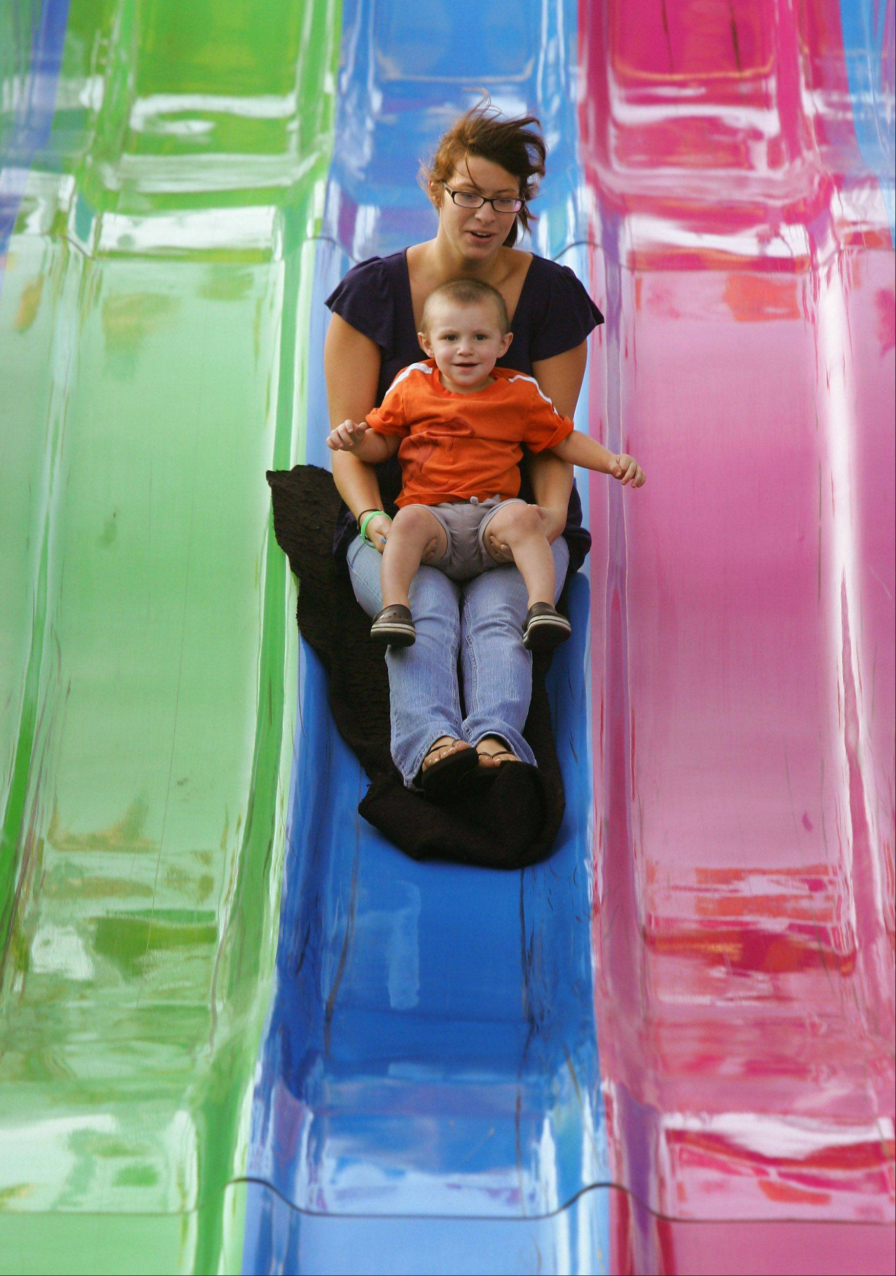 Justine Russo of Lindenhurst and her son, James Menheer, go down the Fun Slide during the 2010 Lake Villa Days.