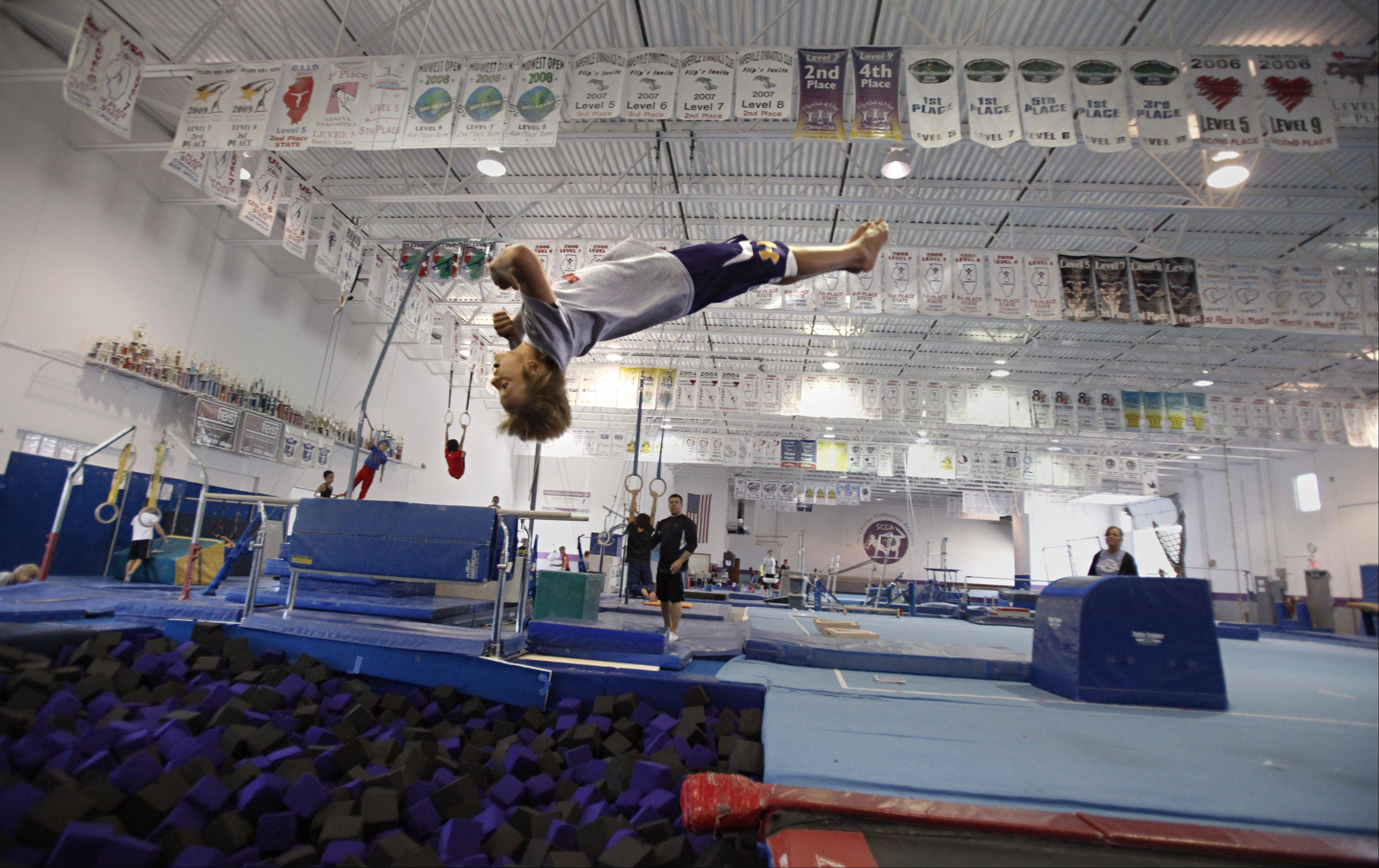 Gymnast Austin Jones, 12, of St. Charles, is recovering from a stress fracture in his wrist but can still soar through the air in impressive fashion. He took the gold medal in the vault and placed 5th in the parallel bars in his age and level at the 2013 Junior Olympic Championships held in Portland, Ore.