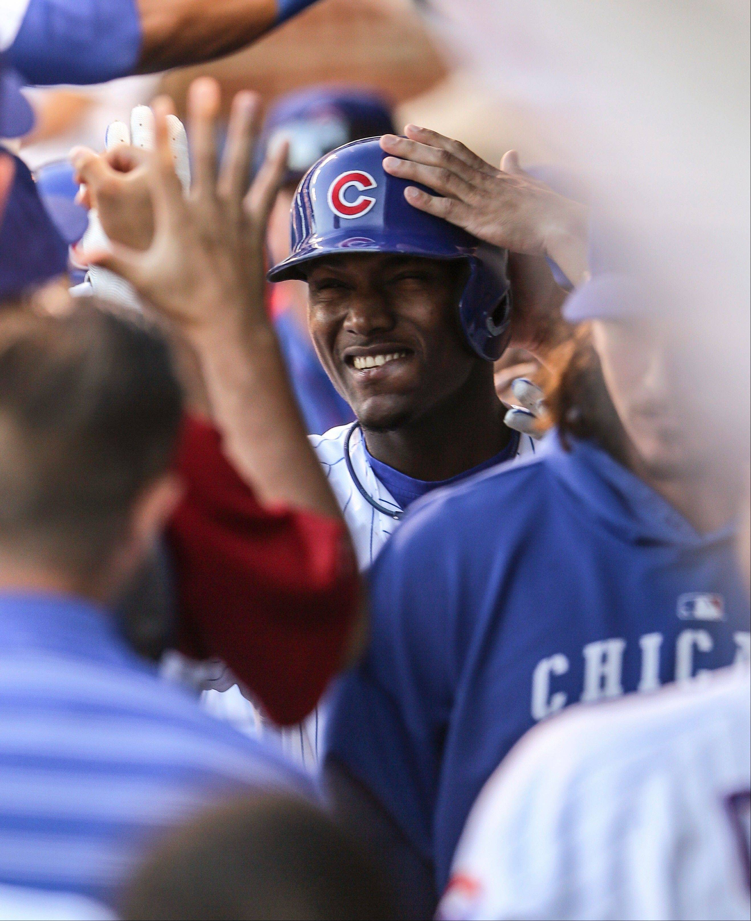 The Cubs' Junior Lake smiles in the dugout after hitting a solo home run in the first inning against the Dodgers on Thursday night.