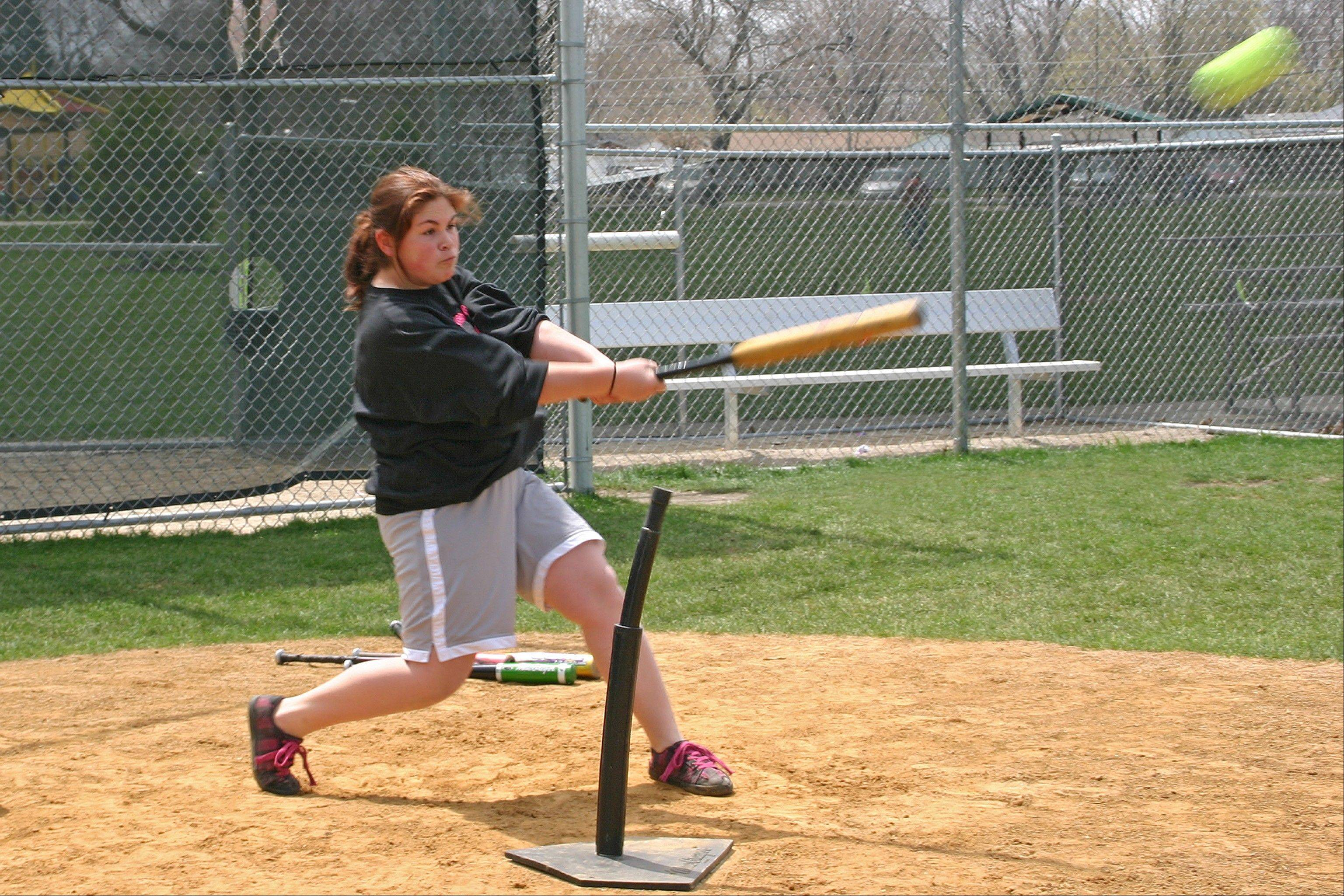 Maren Garnett takes a swing at the April 28 Pitch, Hit & Run competition at West Park.