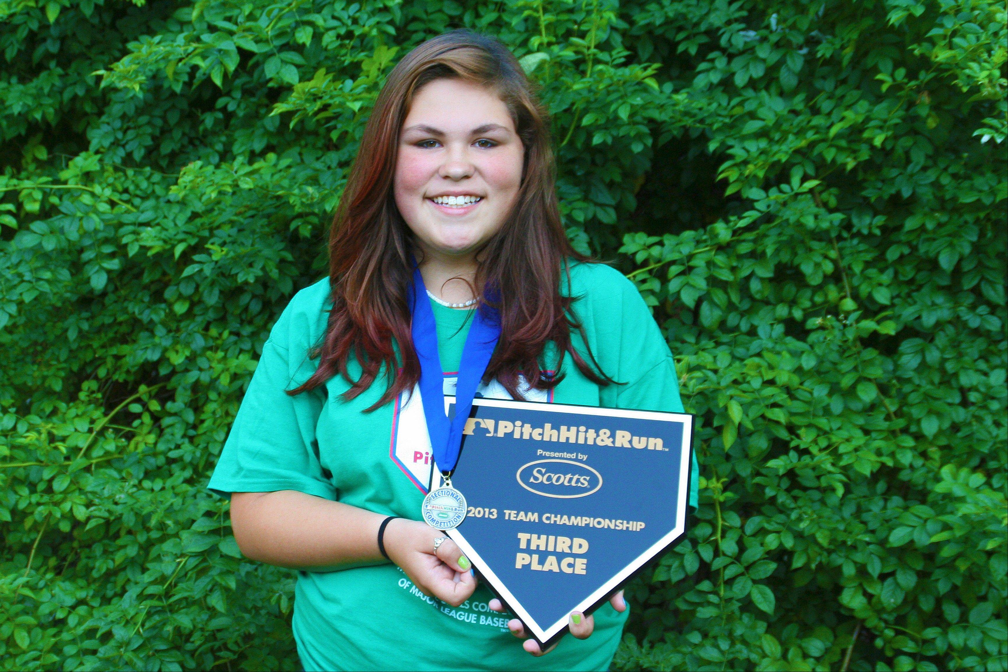 Maren Garnett, 12, of Des Plaines shows off her third-place plaque from the MLB Pitch, Hit & Run Team Championships June 23 at Wrigley Field.
