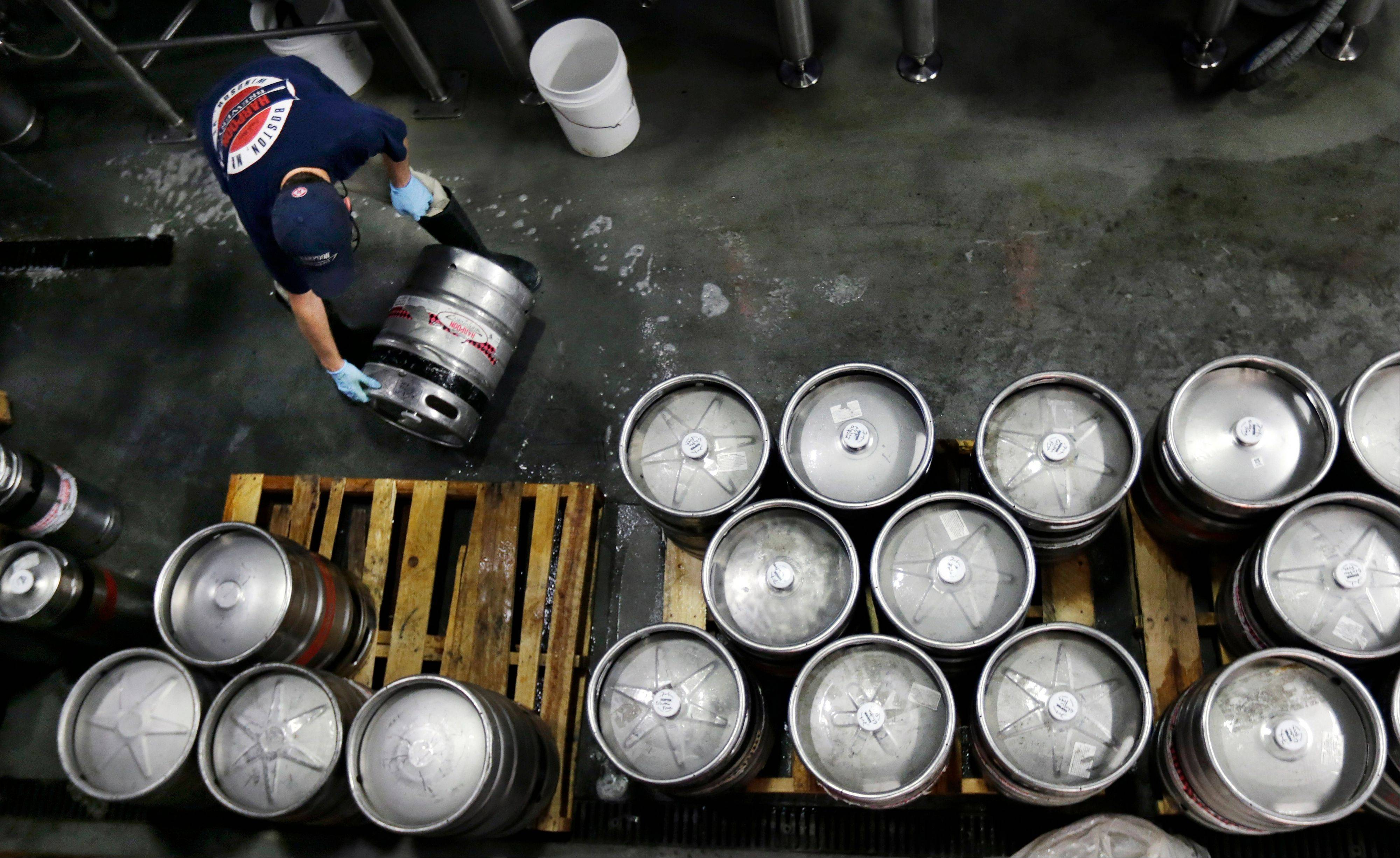 Associated Press/July 1, 2013 Brewer Ken Hermann rolls a fresh keg of beer onto pallets at the Harpoon Brewery in the Seaport District of Boston. The Commerce Department reported Friday on orders placed with U.S. factories in June rose 1.5 percent.