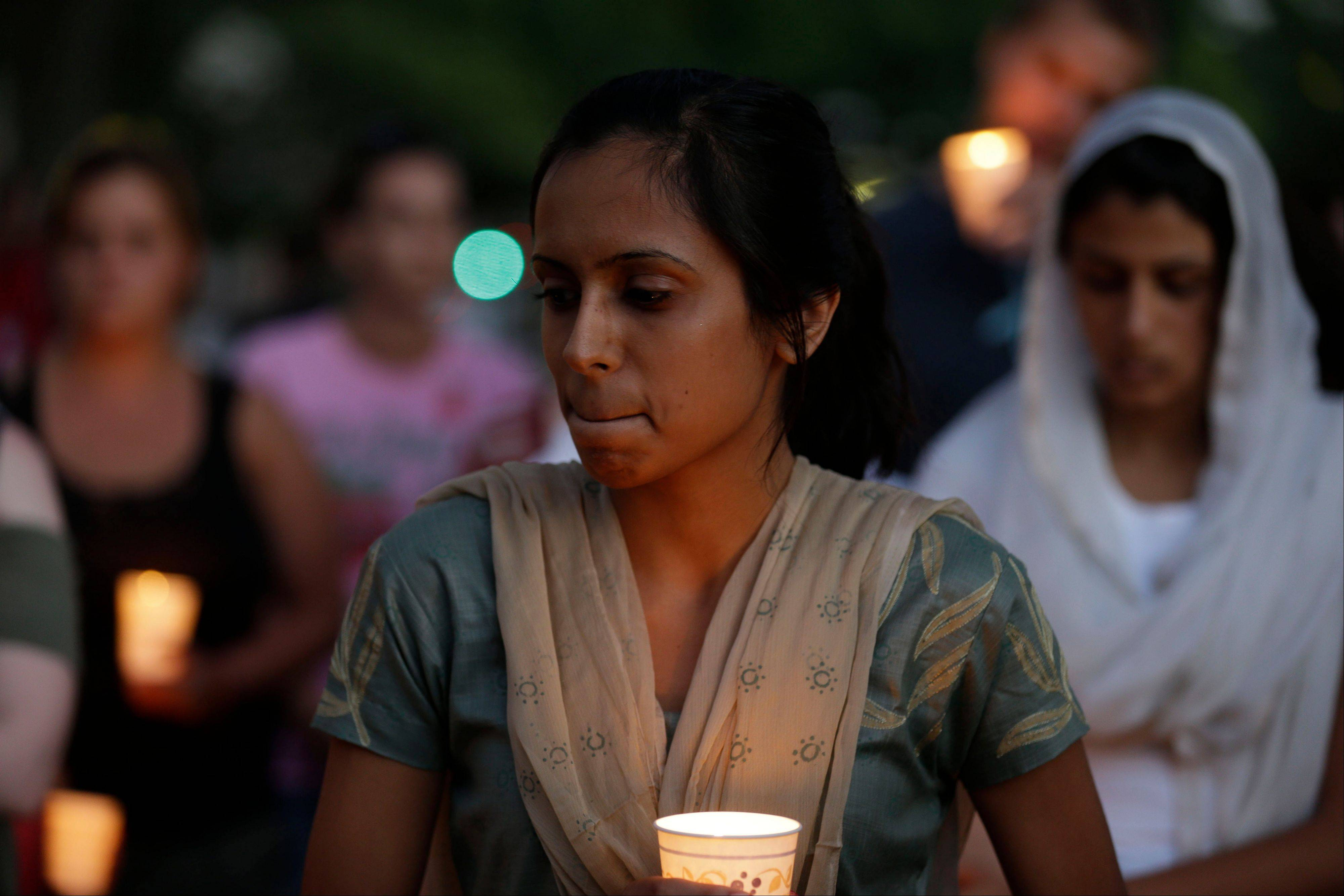 Associated Press/Aug. 5, 2012 Mourners take part in a candlelight vigil for the victims of the Milwaukee-area Sikh temple in Milwaukee.