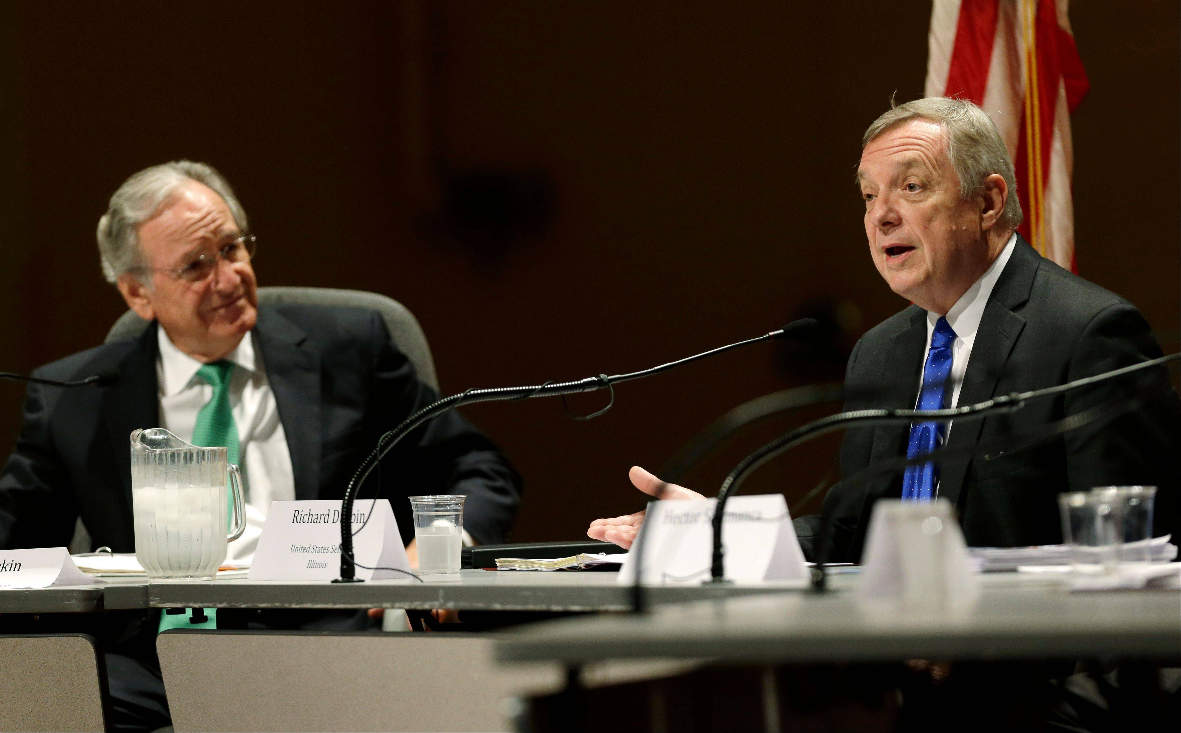 U.S. Sen. Dick Durbin, right, speaks Friday during a forum on immigration. Durbin, of Illinois, the No. 2 Democrat in the Senate, tucked a provision into the 2014 fiscal year defense spending bill that would require the NSA to report to Congress � within 90 days after the legislation becomes law � on the precise number of phone records collected.