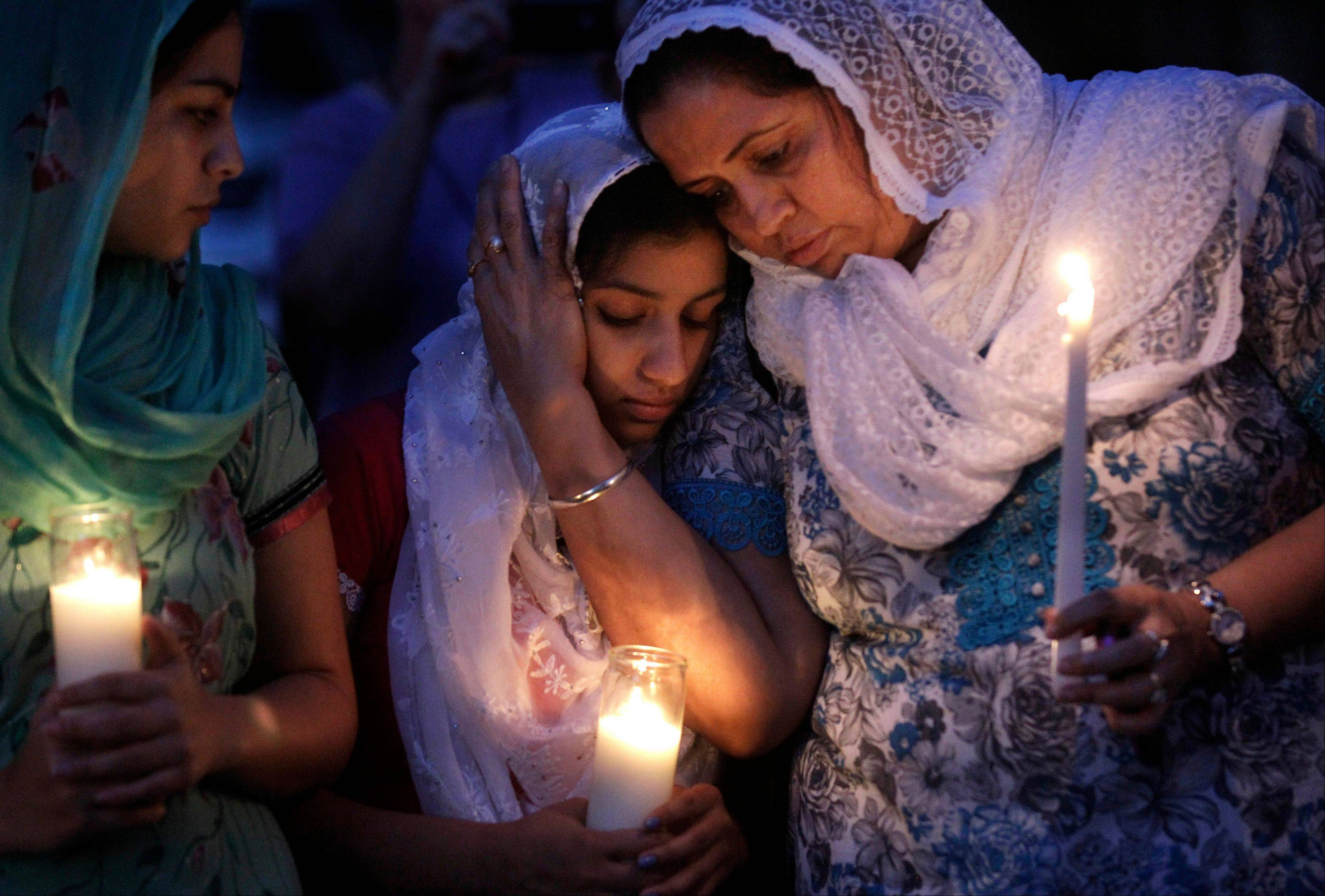 Worshippers from the Sikh community gather for a candle light vigil after prayer services last August in Brookfield, Wis. Twelve months ago, a white supremacist walked into a temple and opened fire, killing six people.