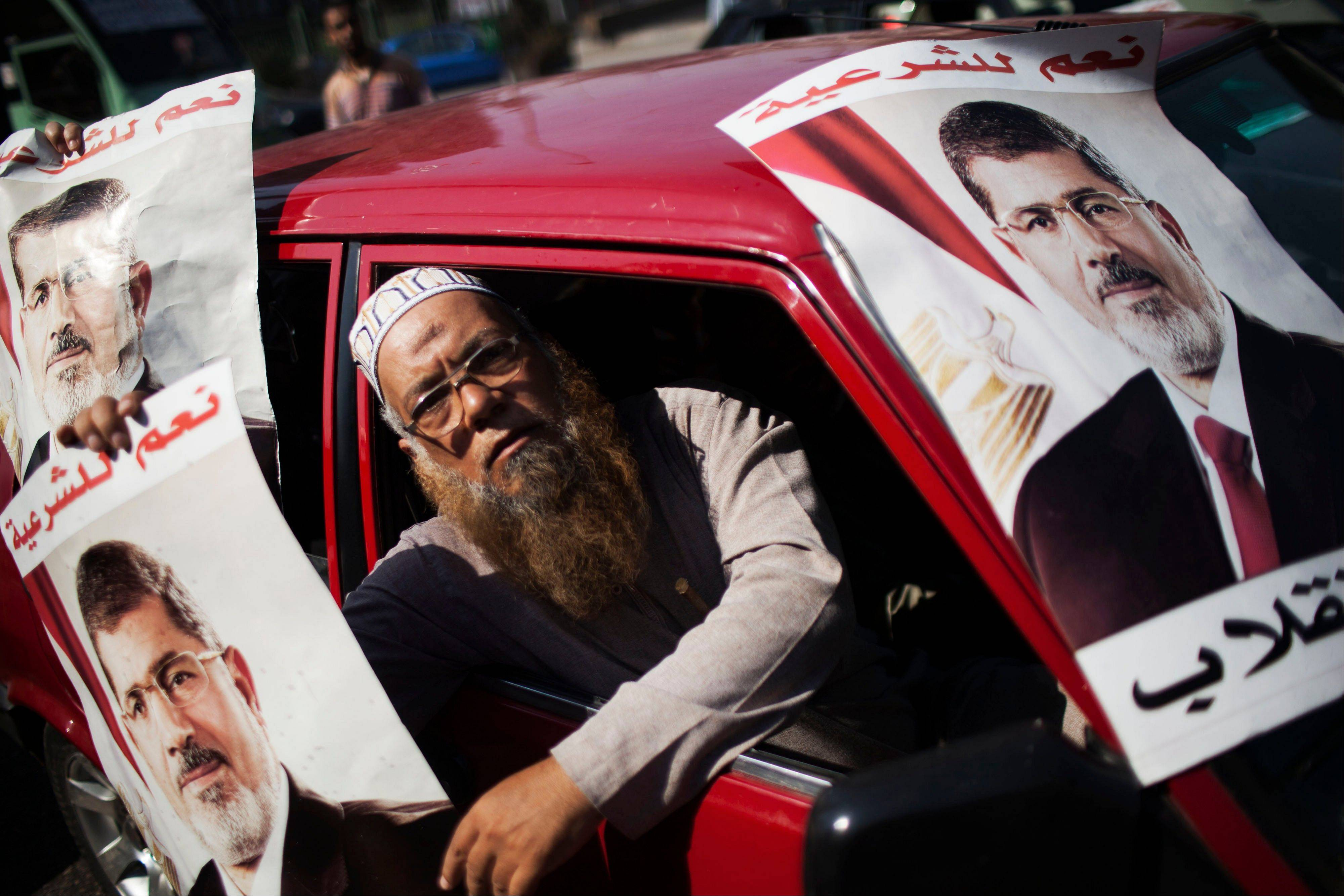 A supporter of Egypt�s ousted President Mohammed Morsi holds a banner Friday with Morsi�s image.