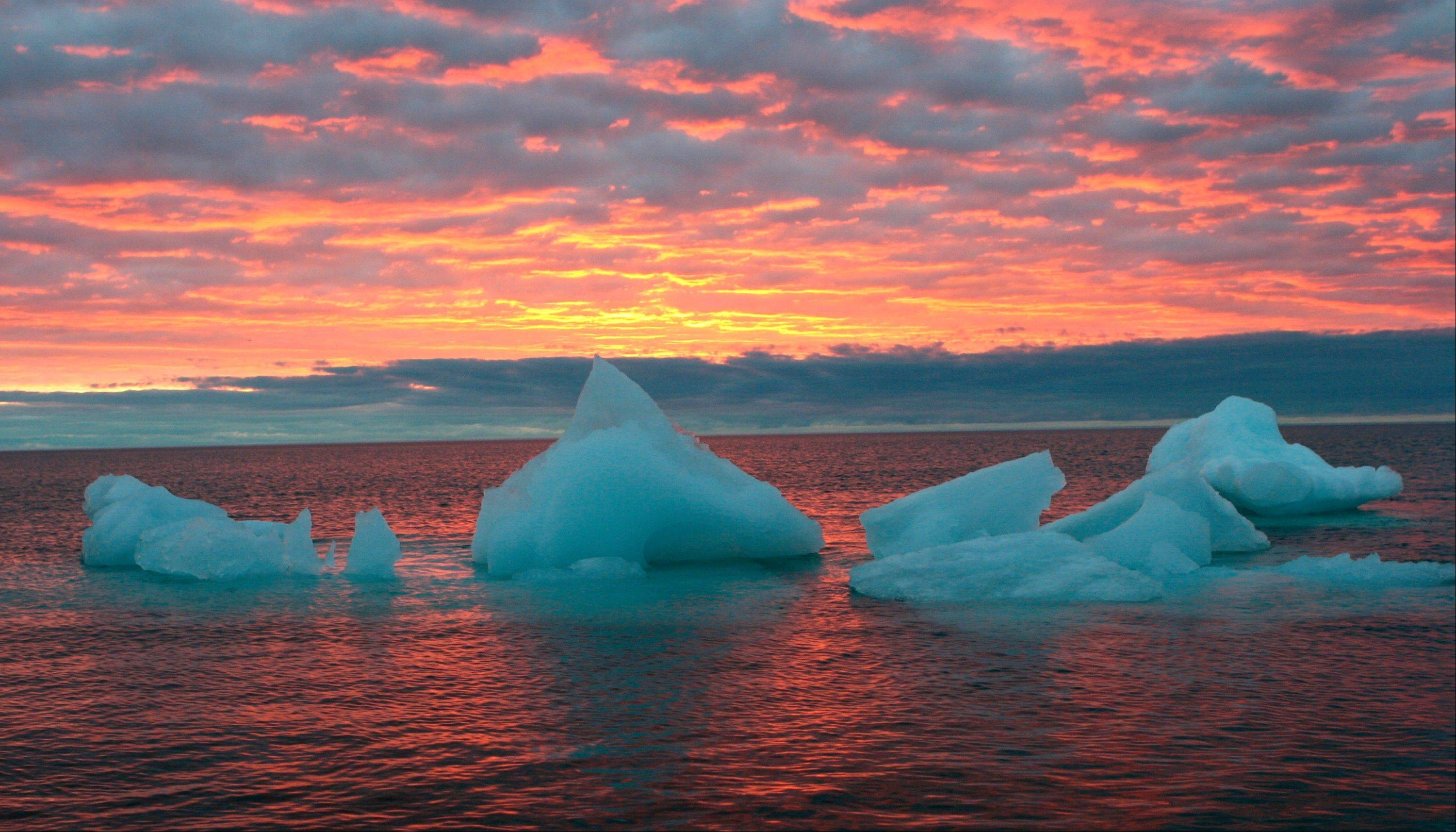 Ice chunks float in the Arctic Ocean as the sun sets near Barrow, Alaska, in this file photo. For the first time since May, the sun has set in what is billed as the northernmost city in the United States.